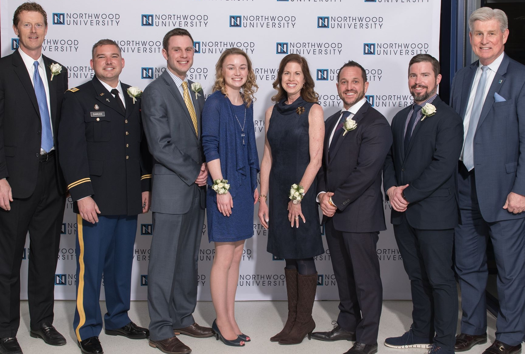 Celebrating Northwood University's Outstanding Alumni Awards with President Keith Pretty are awardees (l-r) Paul Reitz, James Damude, Dan Waskiewicz, Kristina Waskiewicz, Jennifer Williams, Ryan LaFontaine, and Kelly Cheeseman.