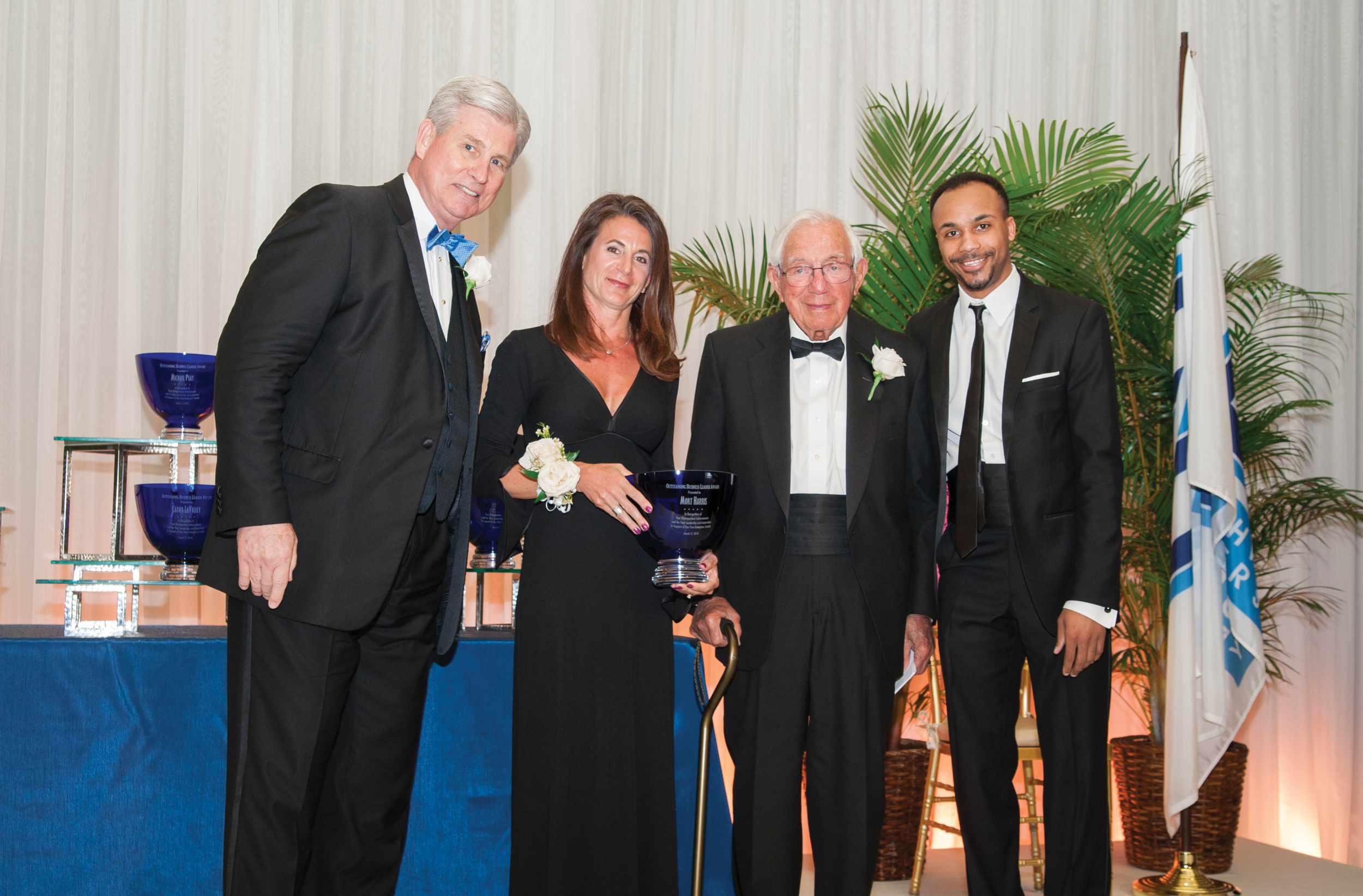 Northwood President Keith Pretty, NU Board Trustee Dr. Jennifer Panning, 2018 Outstanding Business Leaders recipient Mort Harris, and Bretzlaff Foundation Scholarship winner Christopher Grant attend the 2018 Outstanding Business Leader Awards Gala.