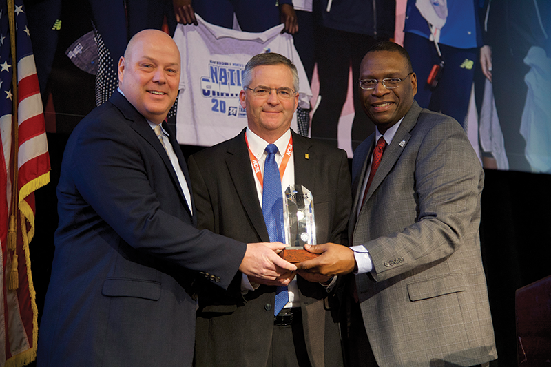 Northwood Dean of Student Affairs Andy Cripe, left, and Athletic Director Dave Marsh, center, accept the 2018 NCAA Award of Excellence from Glen Jones, chairman of the NCAA Division II Presidents Council, at the annual NCAA Convention in Indianapolis.
