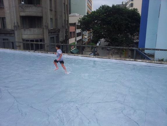 "Architect Luana Geiger's installation ""Piscina no Minhocão"" (Swimming pool on the Minhocão Expressway) used tarp to create a temporary, Olympic length shallow pool on a highway in São Paulo, 2014. Courtesy of Fabio Namiki."