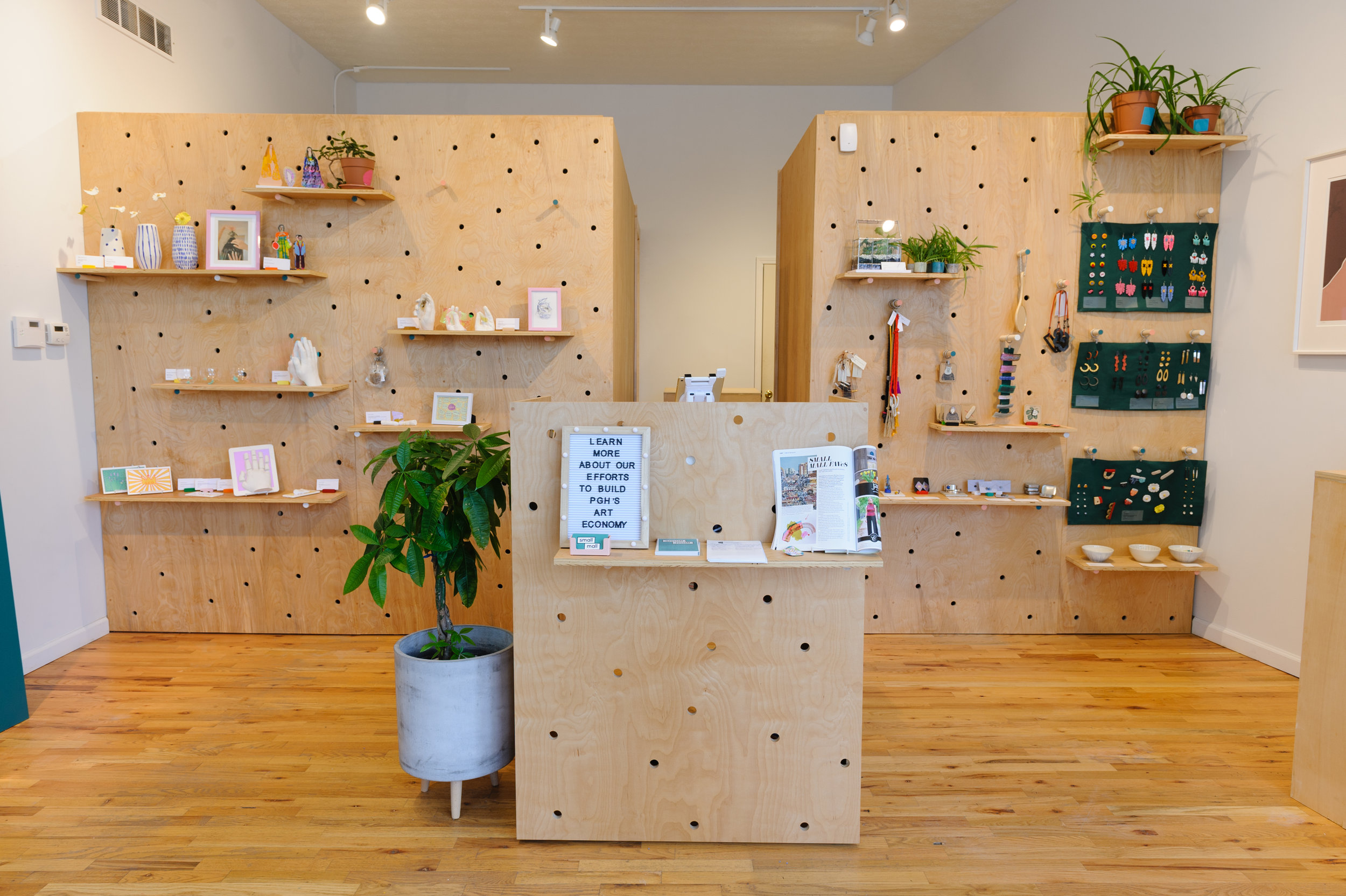 Interior of Small Mall, the brick and mortar retail outpost and office of Casey Droege Cultural Productions in Lawrenceville, Pittsburgh. Courtesy Porter Loves Creative.