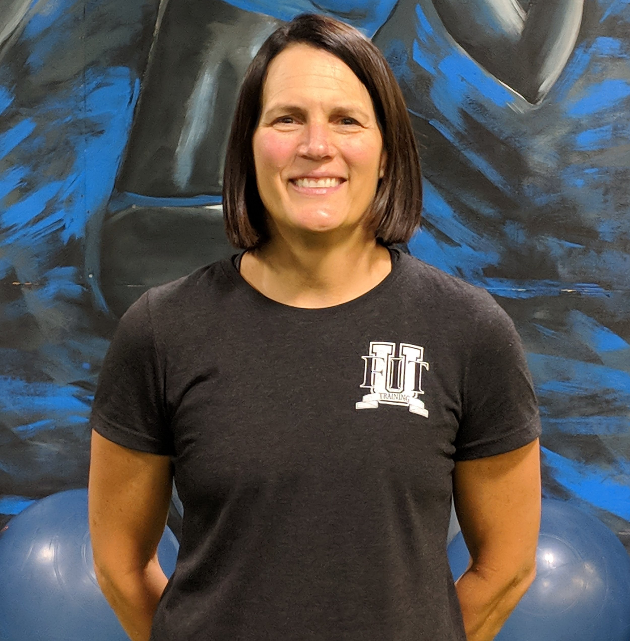 Stacy Buster - I am the founder/owner of FIT U Training 360. I grew up in San Diego moving to West Texas during high school. I decided to attend Texas Tech with the intent to become a Physical Therapist. Having always loved sports and fitness-based activities, I decided to change my major two years into college. In 1987, I graduated with a BS in Exercise Science and a minor in biology. My desire to work in cardiac rehab led me to pursue my nursing license.I became an RN in 1992 and worked in cardiac rehab for years before moving to Southern Maryland. This career choice allowed me to use both my college degree and my RN. When we first moved here, I worked at the local hospital as well as home health as an RN. In 2004, I started working at a local gym as a personal trainer, and eventually became the director of training. Realizing the need for something other than a basic gym here in SoMD, I had the vision for FIT U. I set out to develop a fitness and performance-based facility, which has since turned into more than I could have ever imagined back in 2011.My husband Alan and I moved to St Mary's in January 2000 with our 3 daughters, Emily, Erin and Morgan(twins). Our girls all played travel soccer. The twins are in college and the oldest has graduated and works at FIT U. I love watching sports, especially soccer and football. I am also a huge animal lover, with a huge soft spot for dogs. We have three of our own rescued pups!! I enjoy vacations at the lake, boating, hiking, and working out with all the different
