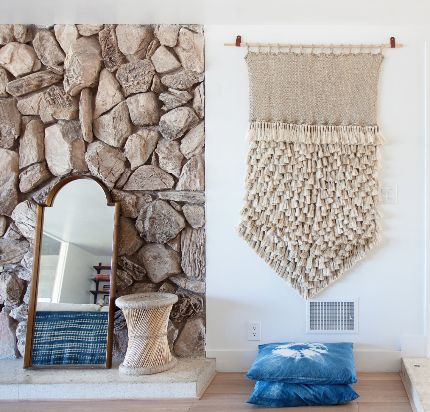 Natalie Myers with Veneer Designs  does a woven wall hanging like a champ in her Ladera Heights remodel.Love this neutral texture next to that mid century stone fireplace face, accented with the pop of indigo from the floor cushions. Perfect Bohemian harmony.