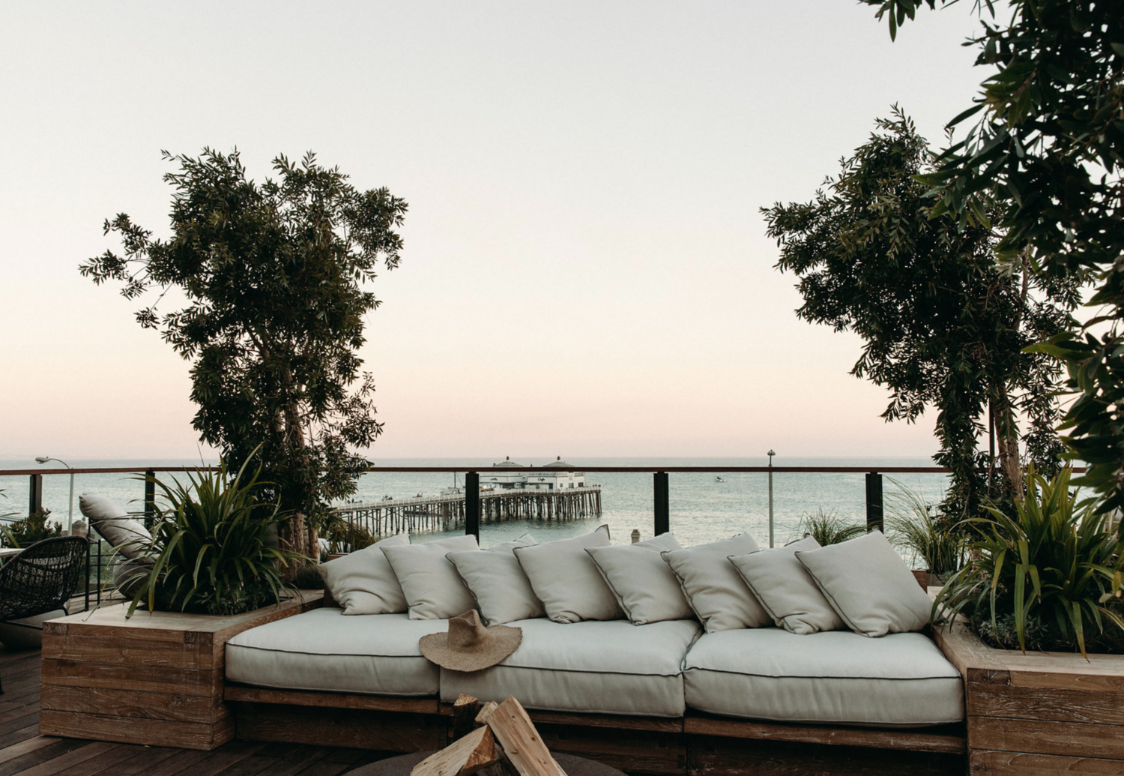 get the look: surfrider malibu, coastal modern beach house decor, vintage rug, modern bohemian interiors, neutral dining room design