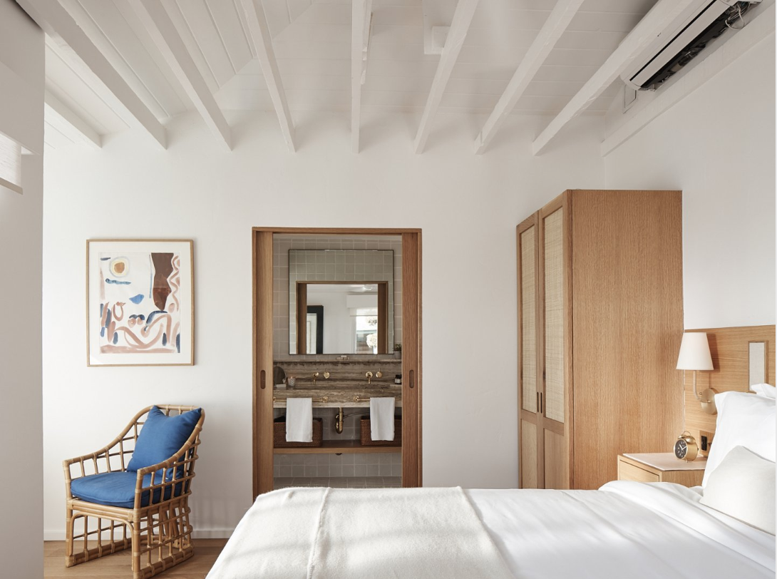 white beam open ceilings, rustic modern bohemian interiors, hotel joaquin