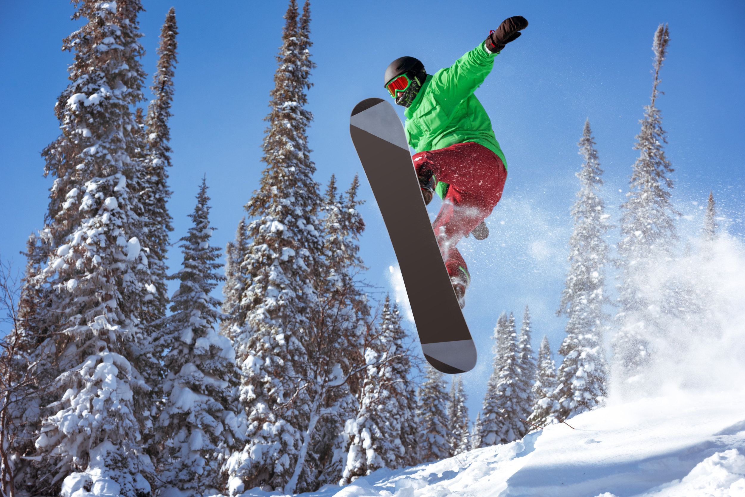Action shot of a snowboarder in the air.