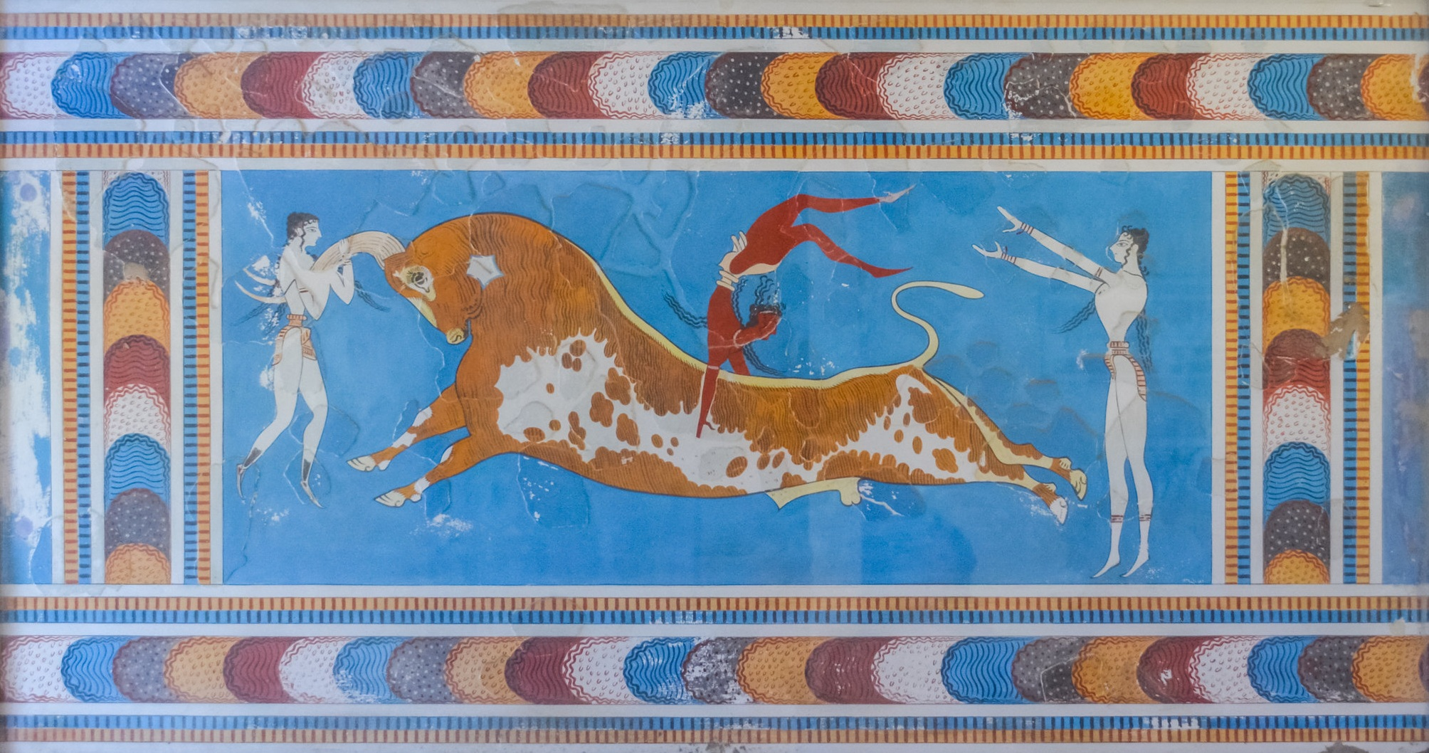 Ancient Greek Minoan wall art depicts humans jumping over the top of a bull's back.