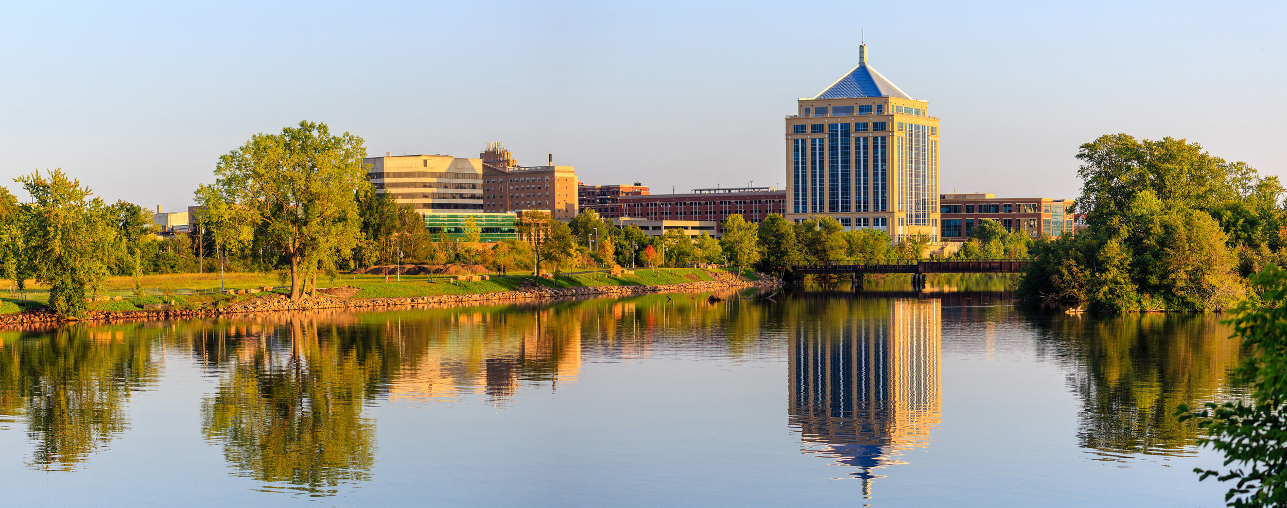 Downtown Wausau, WI cityscape along the Wisconsin River at sunset.