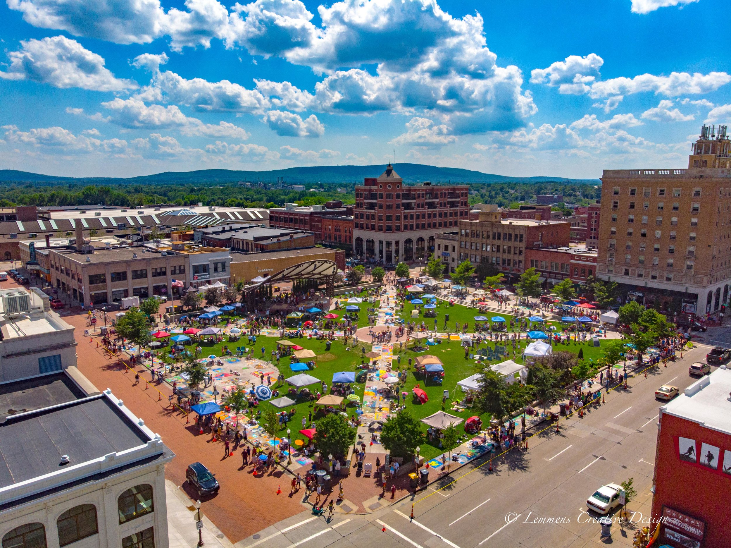 Aerial view of Wausau's 400 block covered in tents and people for a festival.