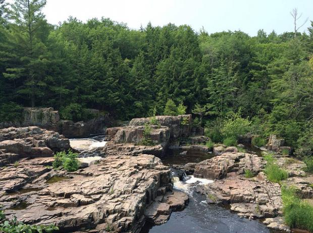 View of the rock formations and whitewater river at the Eau Claire Dells