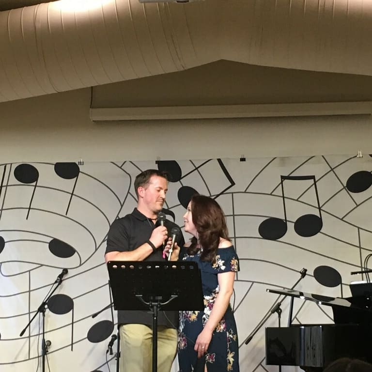 Married couple Ryan & Angela singing a love song to one another at our Cabaret Fundraiser Night 2018.