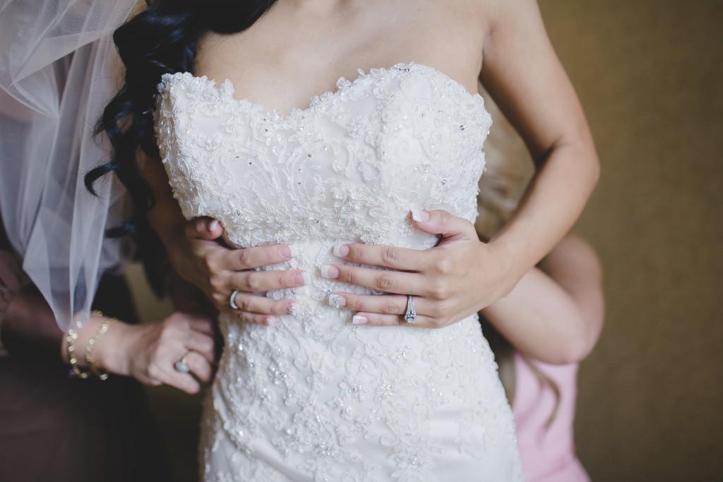 bride-getting-in-dress