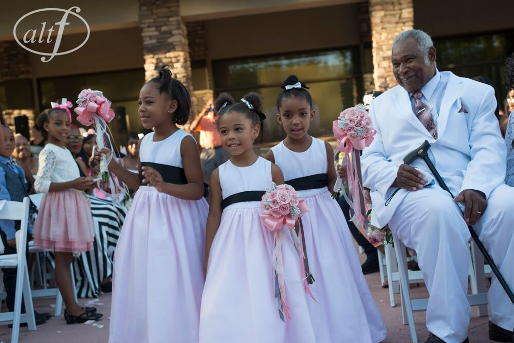 Flower girls wearing pink and black