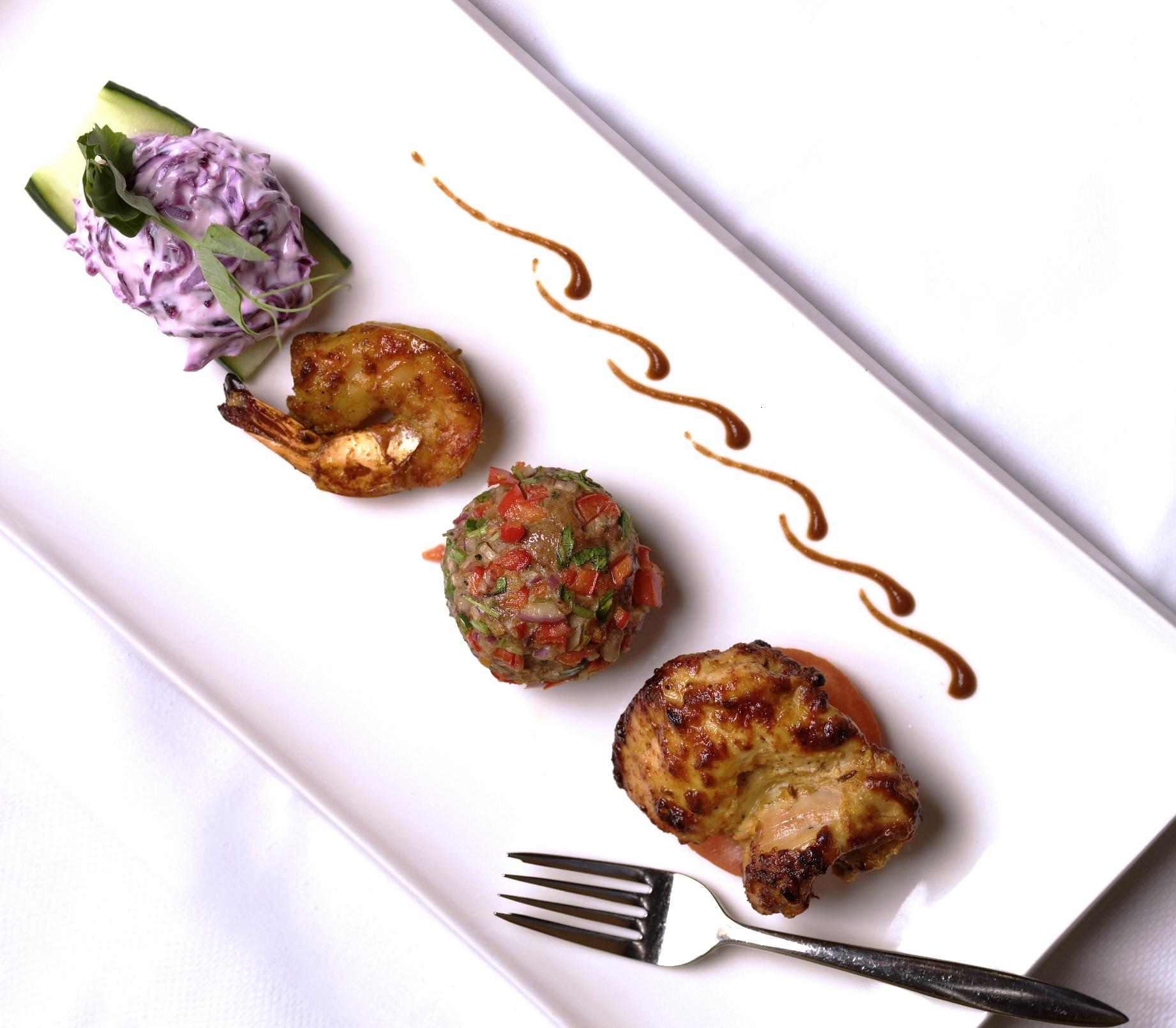 Origin India kebab platter of tiger prawn, organic chicken breast and paneer cheese tikka and lamb kebab - resized