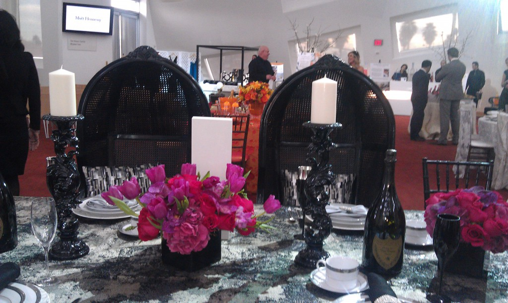 black chairs with hot pink and black tablescape, dom perignon