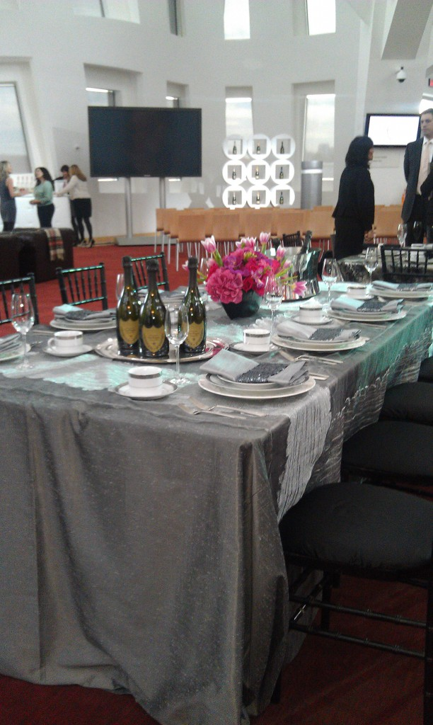 gray and pink tablescape with dom perignon