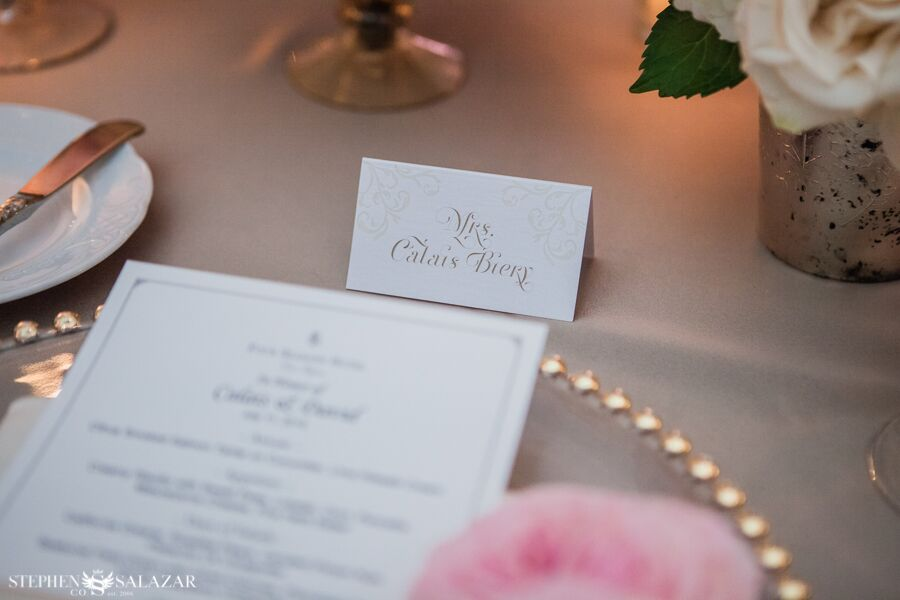 menu card and place card on a charger plate