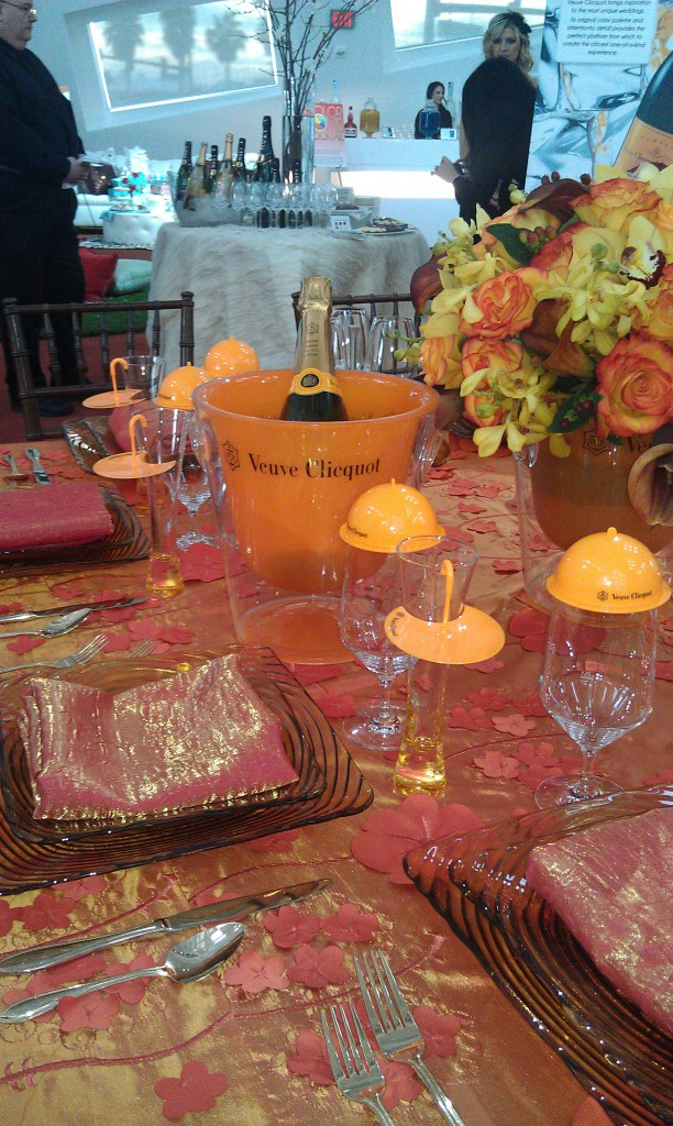 orange table setting with veuve clicquot