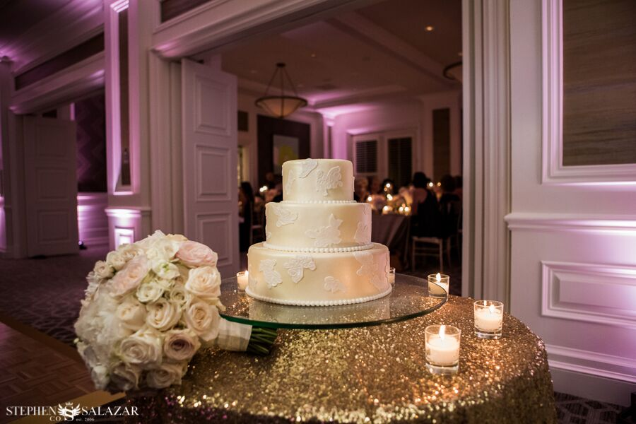 wedding cake with gold sequined linen