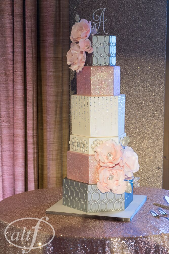 wedding cake with silver and pink and bling