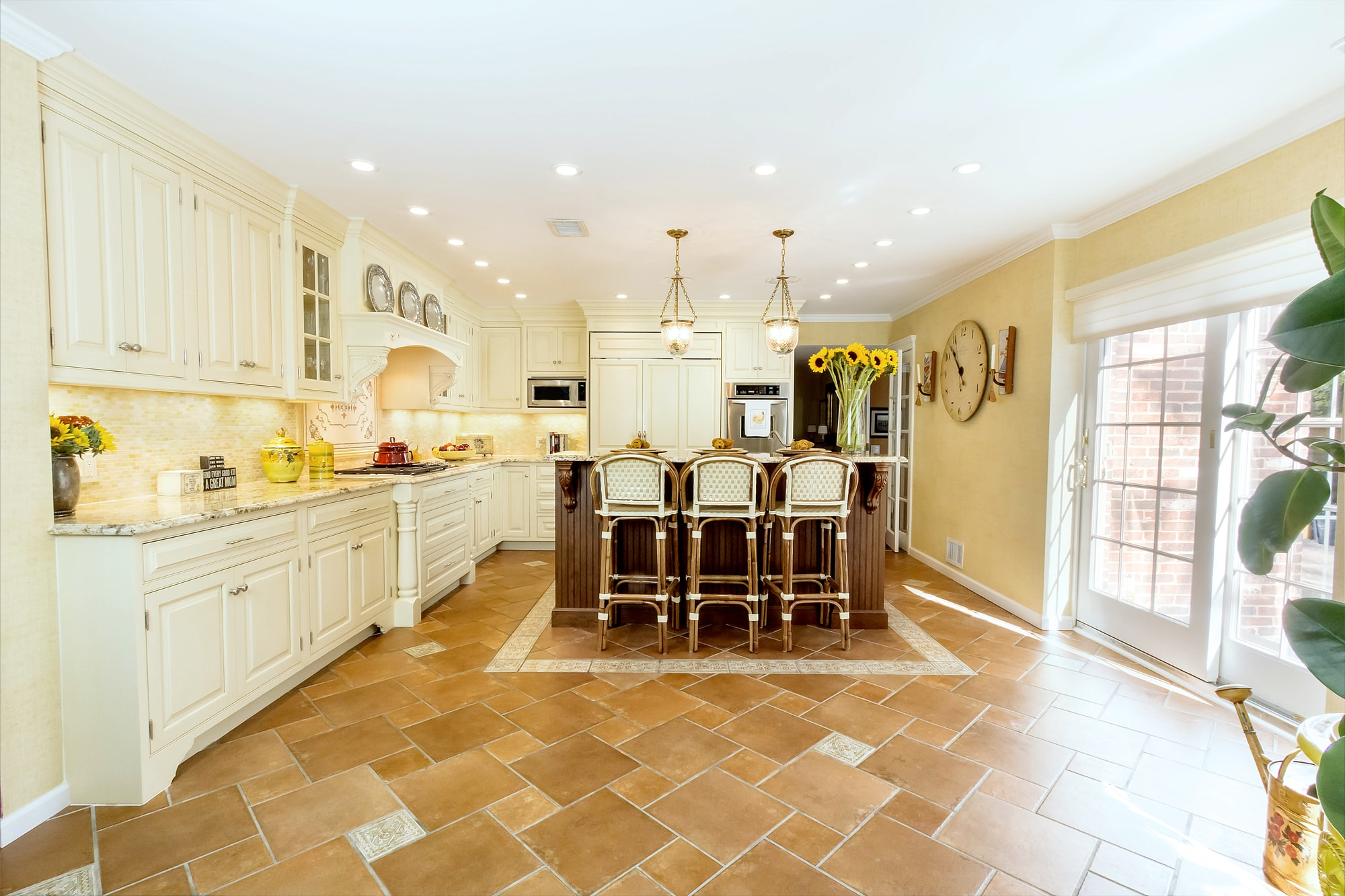 Traditional style kitchen with spacious floor and brown tile