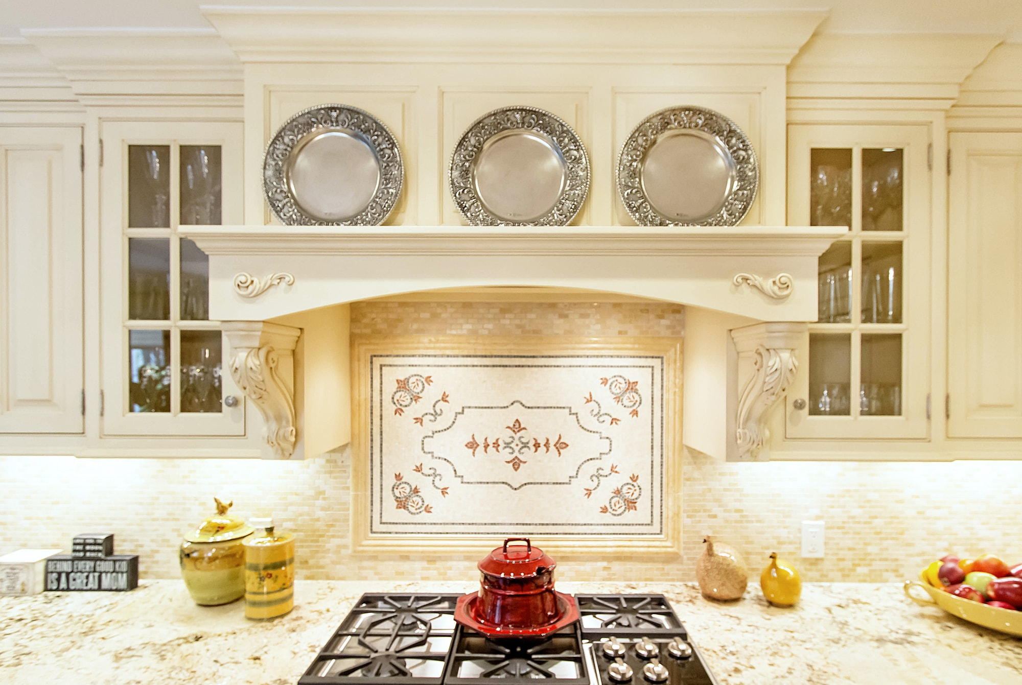 Traditional style kitchen gas range with custom tile backsplash