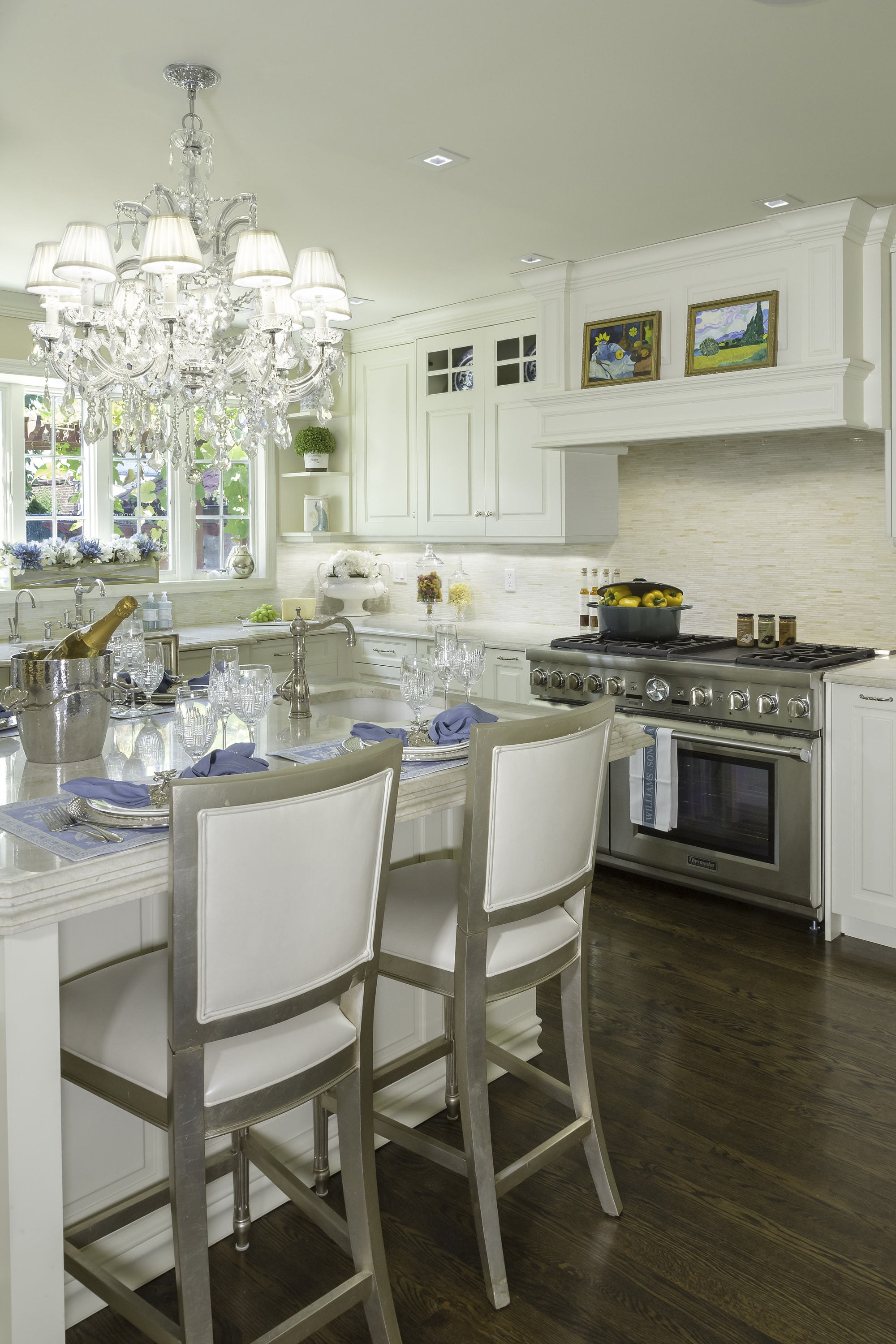 Traditional style kitchen with white kitchen cabinets and breakfast table