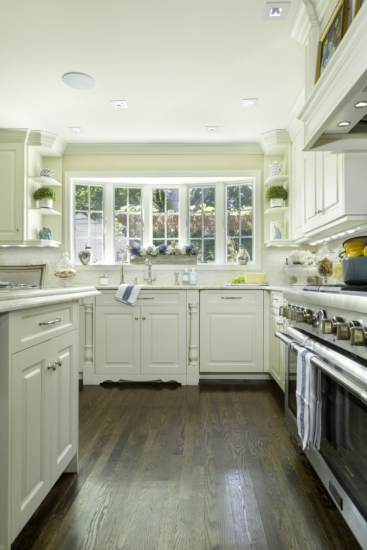 Traditional style kitchen with elegant hardwood flooring