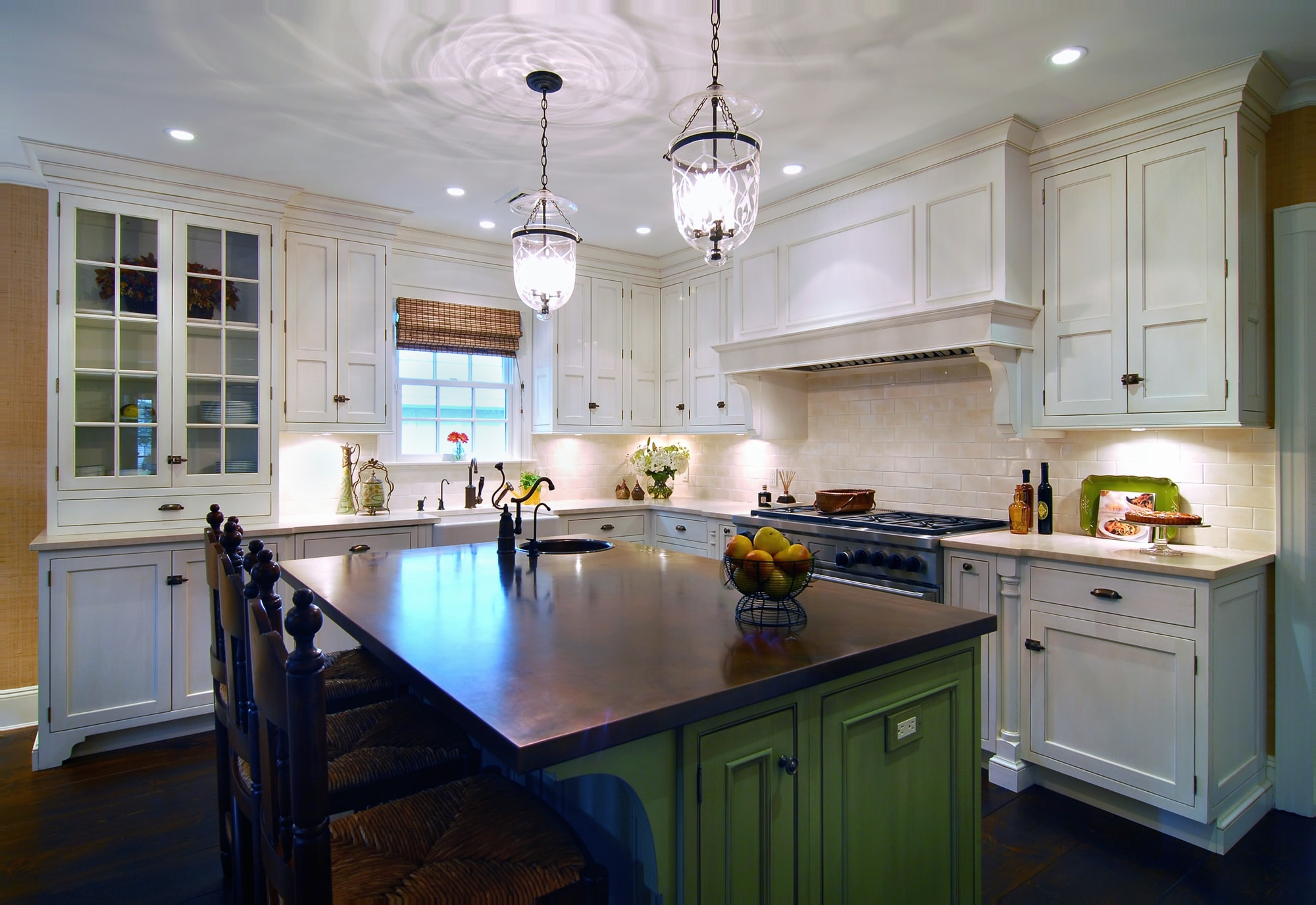 Traditional style kitchen island with vintage faucet