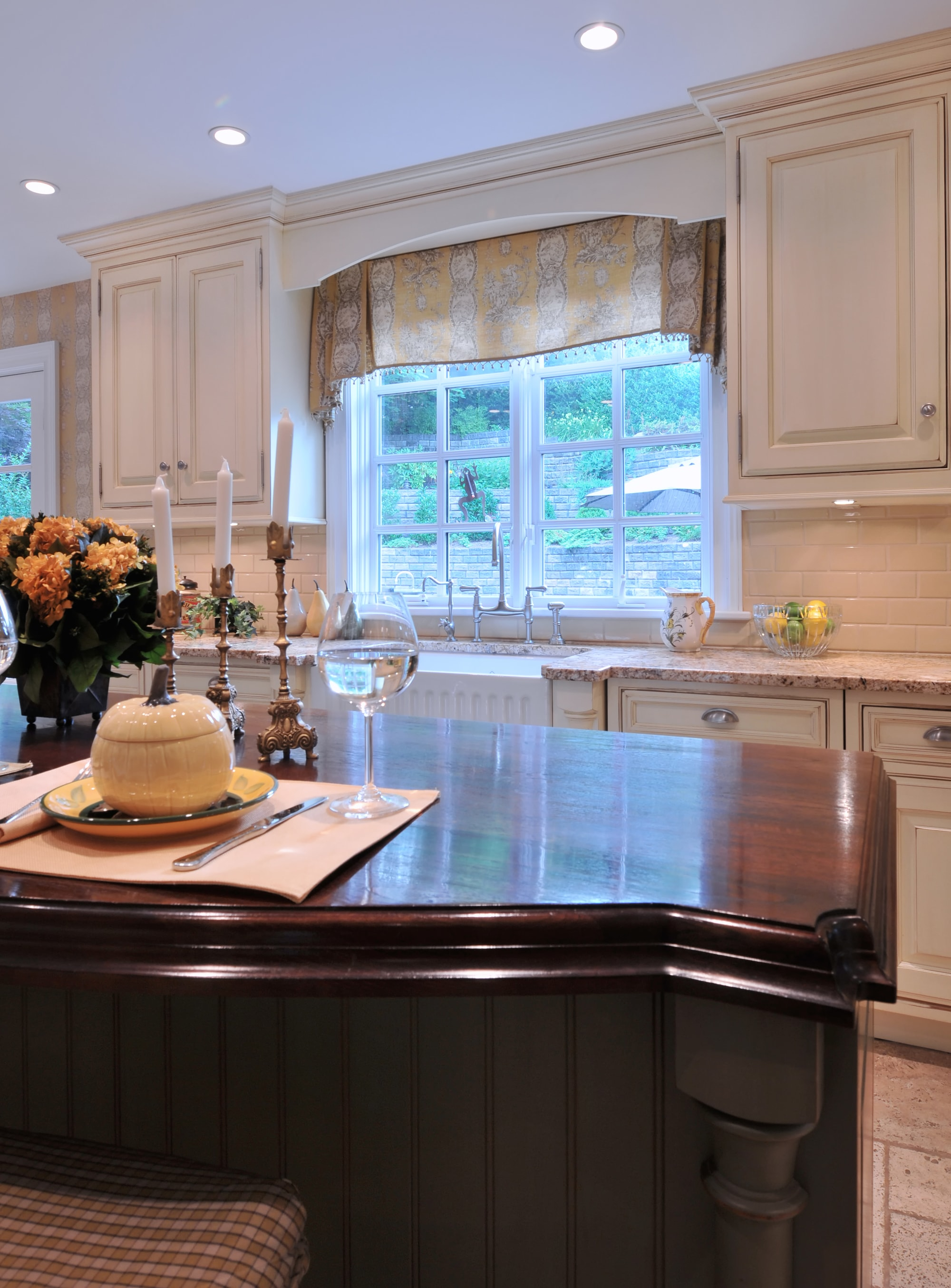 Traditional style kitchen with a classic french window and upper cabinets