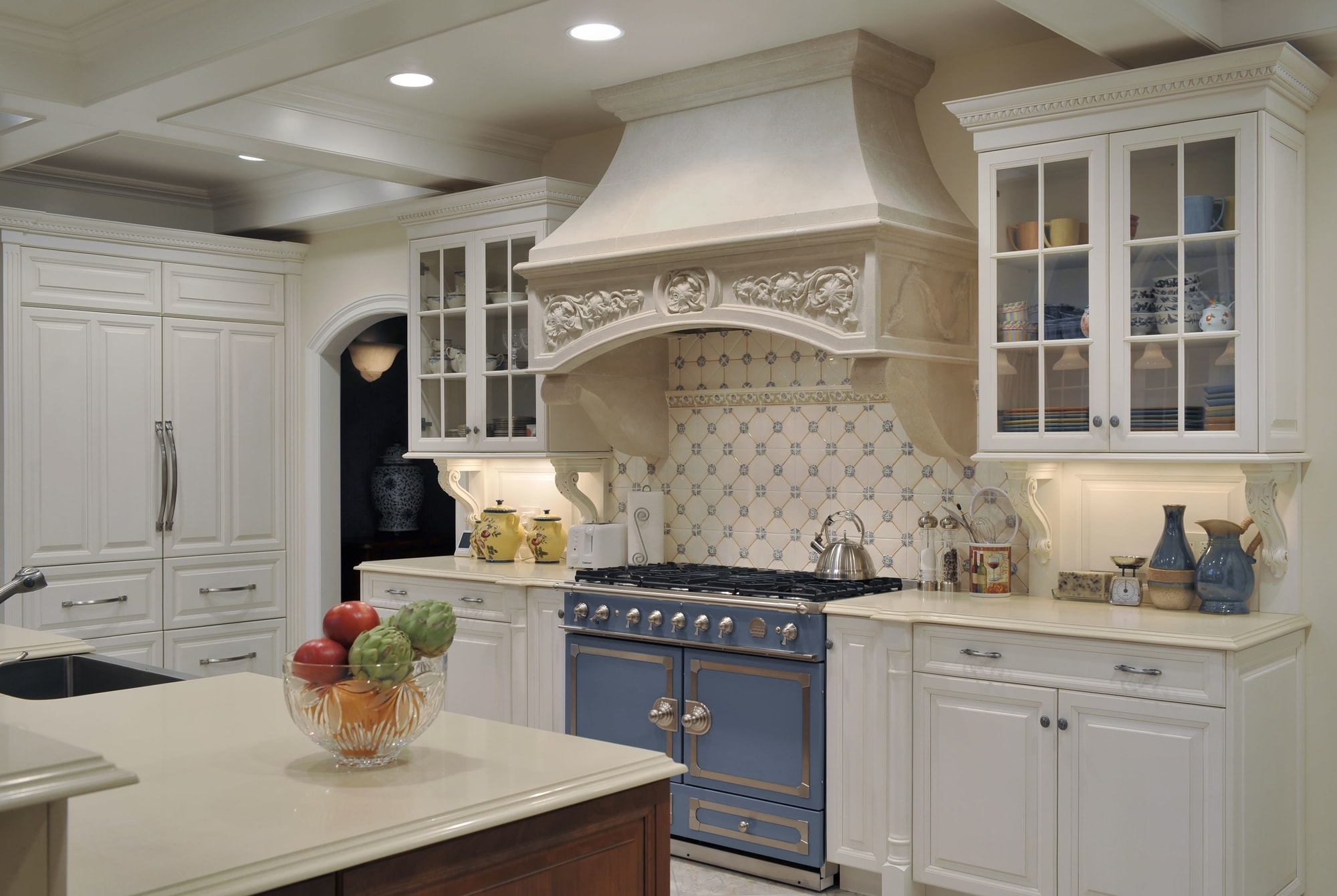 Traditional style kitchen with customer design range hood