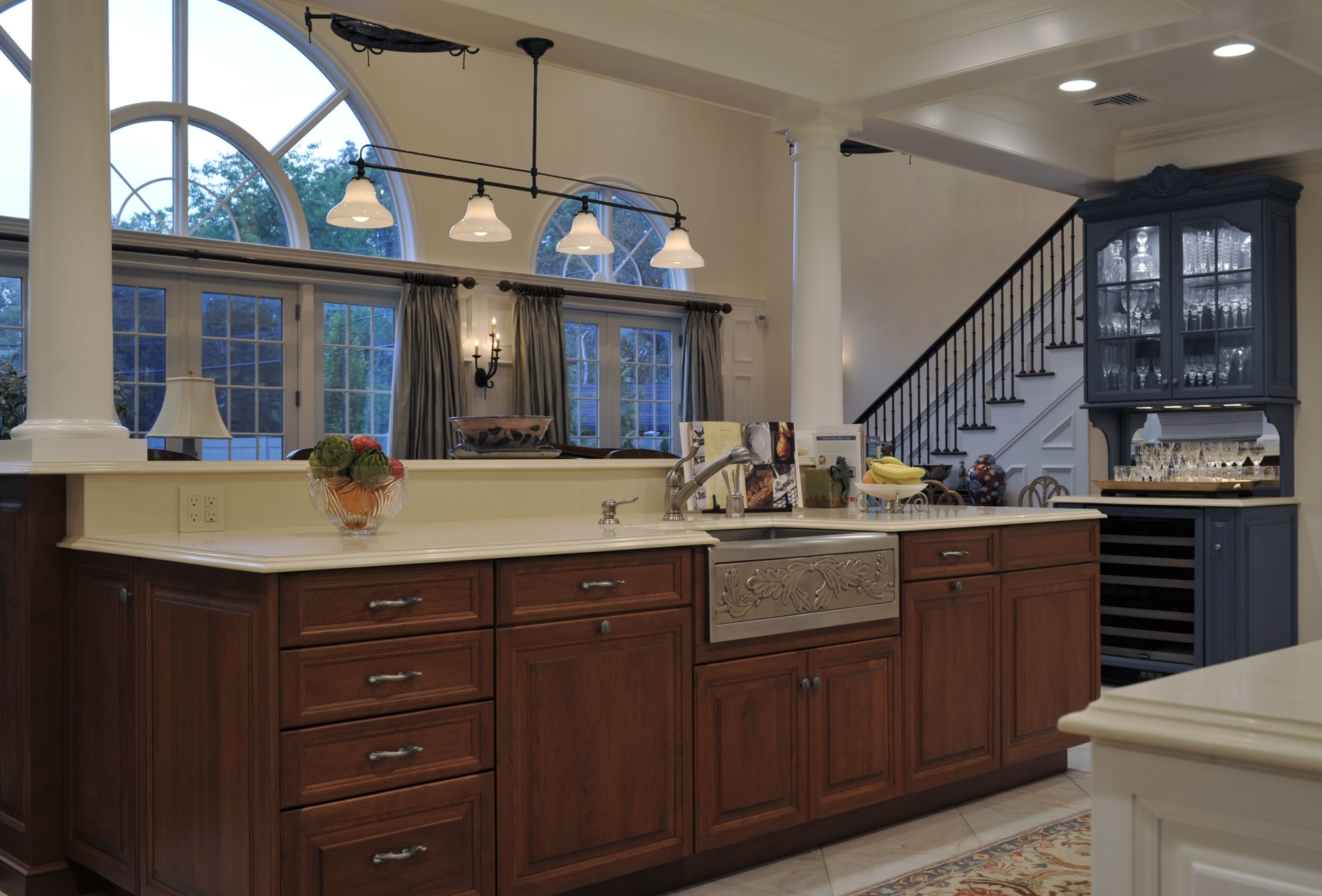 Traditional style kitchen with wine glass cabinet
