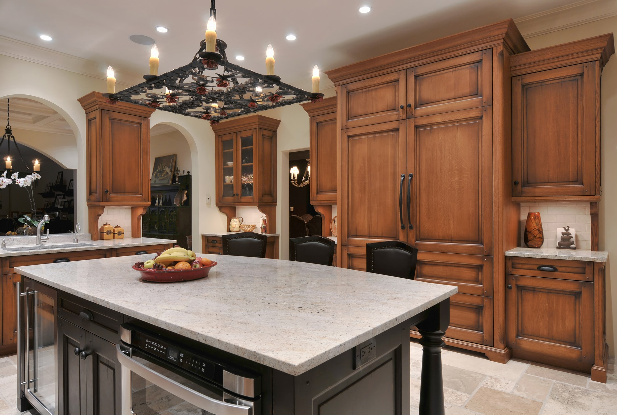 Traditional style kitchen island with hanging chandelier