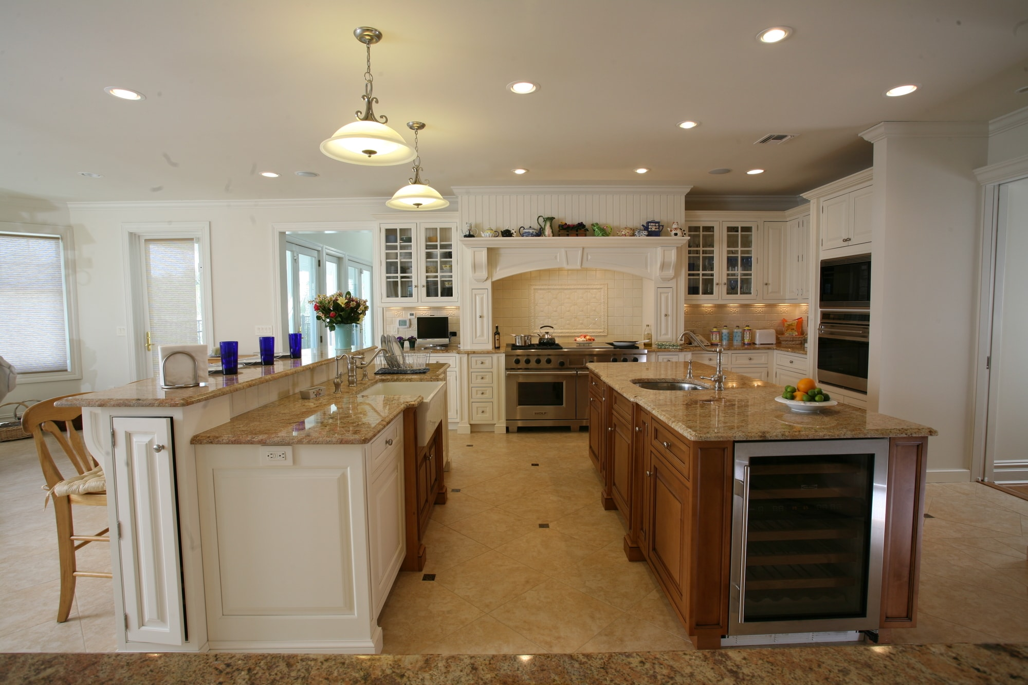 Traditional style kitchen with faucet on each kitchen island