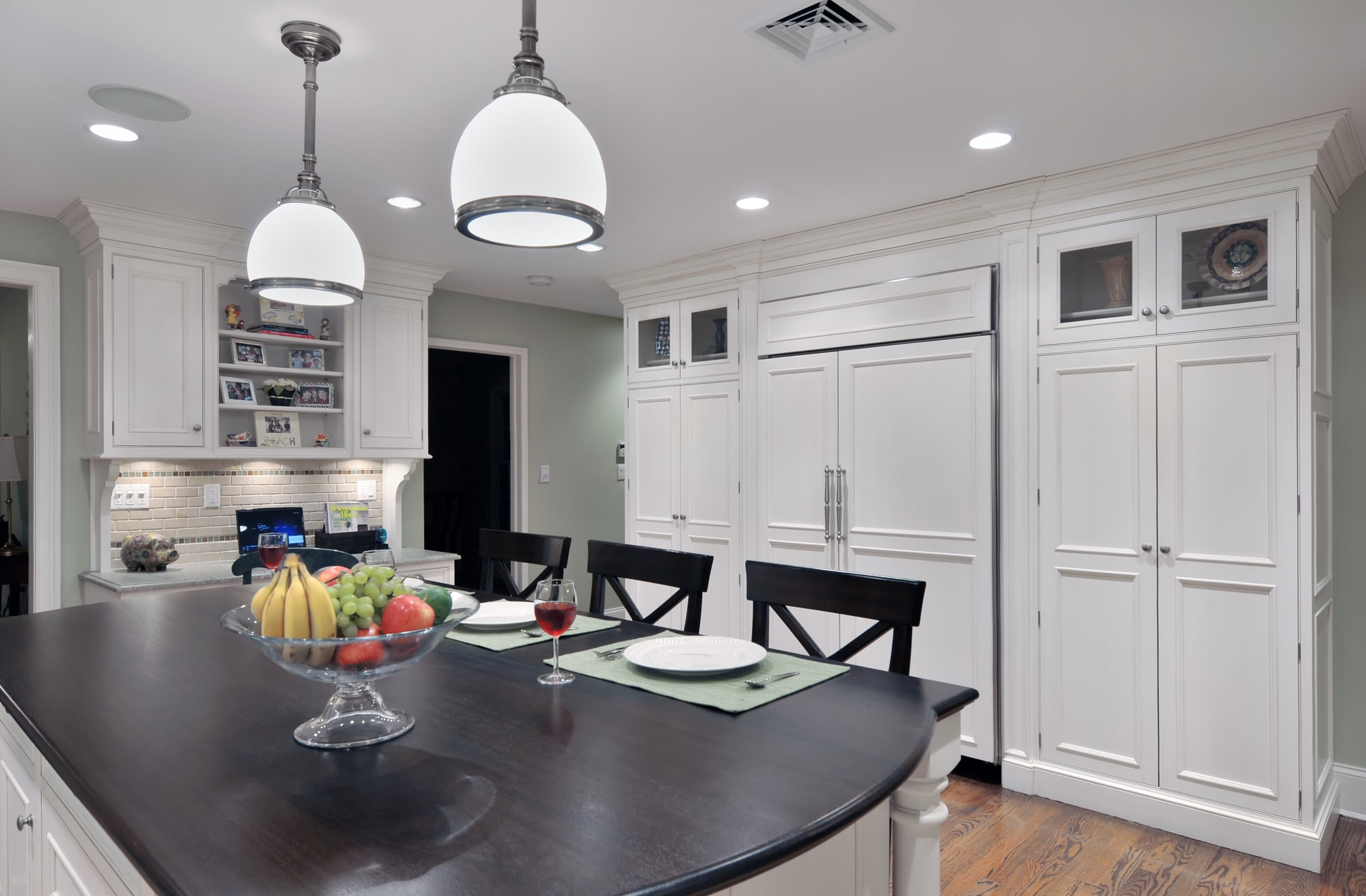 Traditional style kitchen with with modern light fixtures