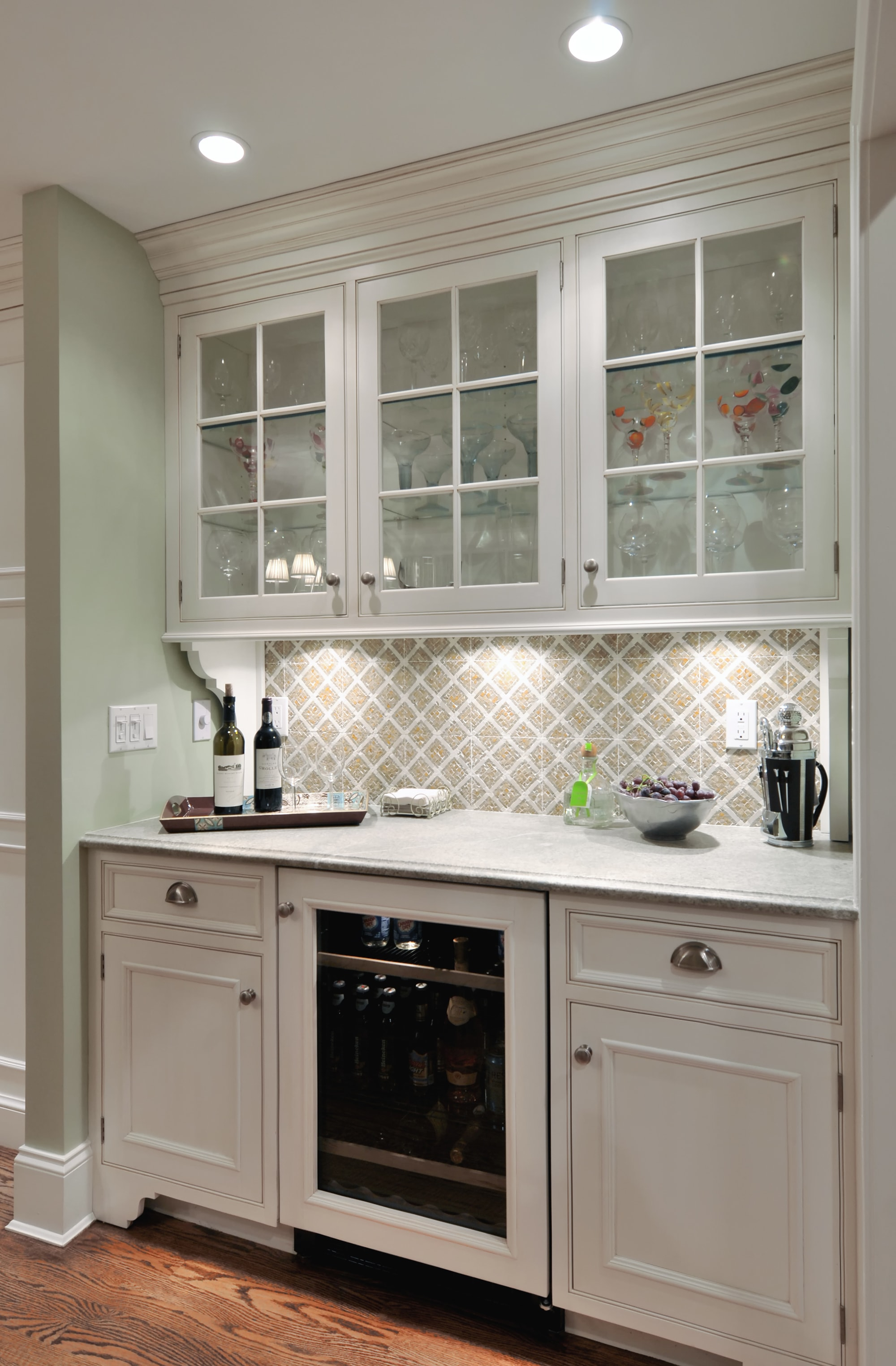 Traditional style kitchen with glass cabinets and small wine storage