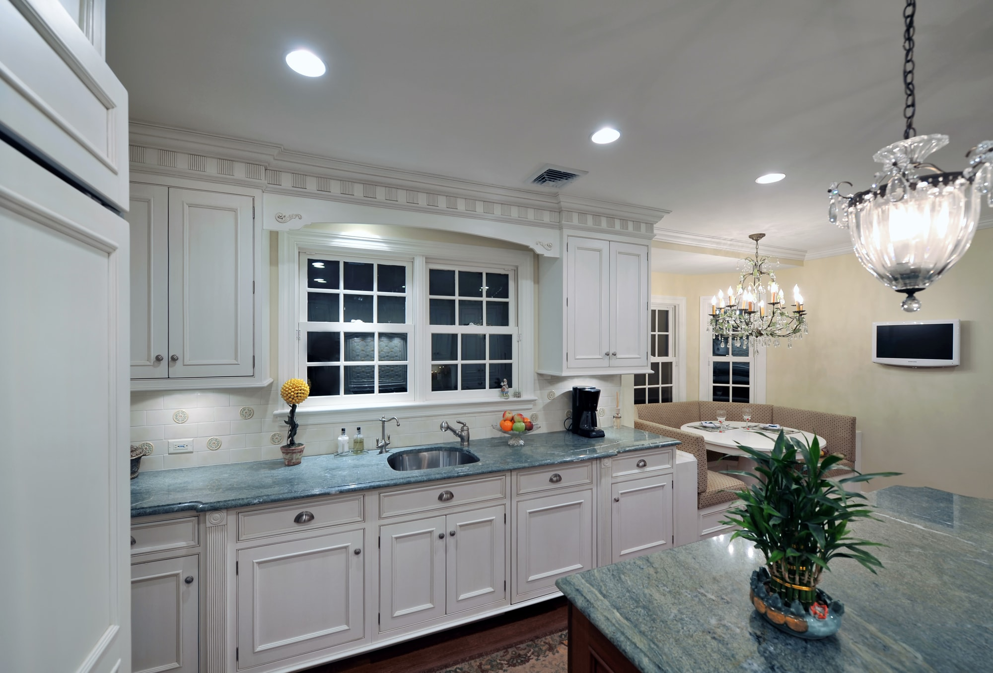 Traditional style kitchen with breakfast table in the corner