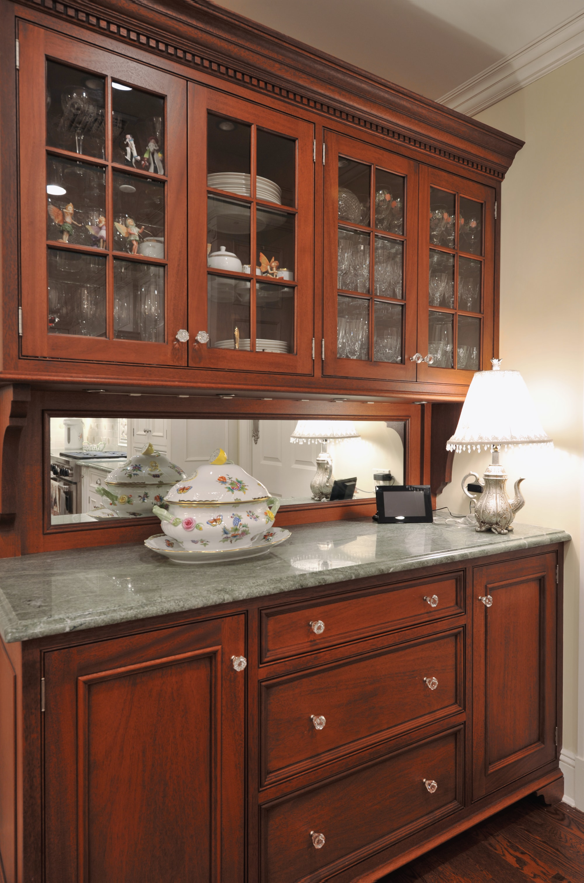 Traditional style kitchen with spacious glass cabinets