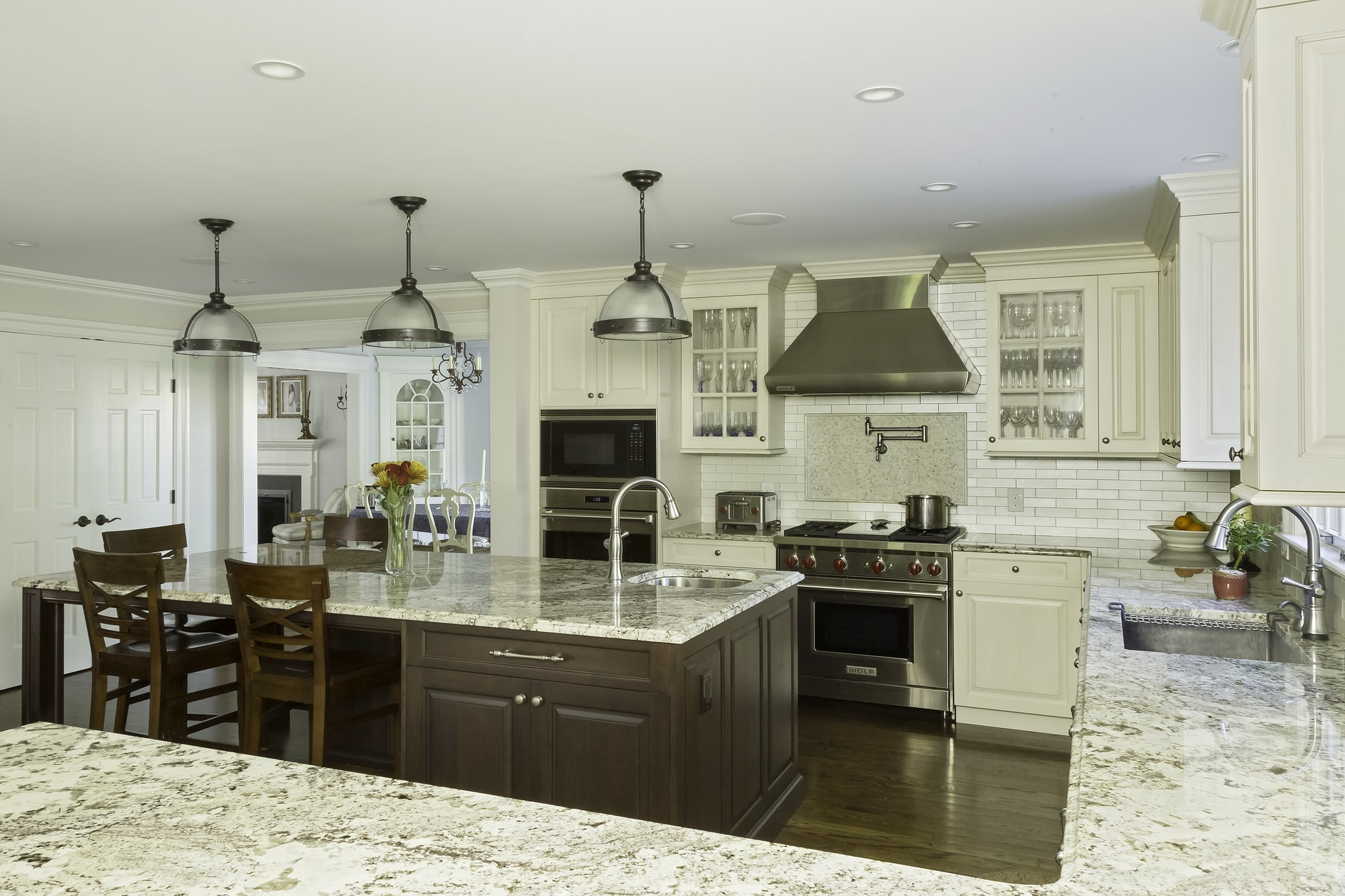 Traditional style kitchen with with wine glass cabinet