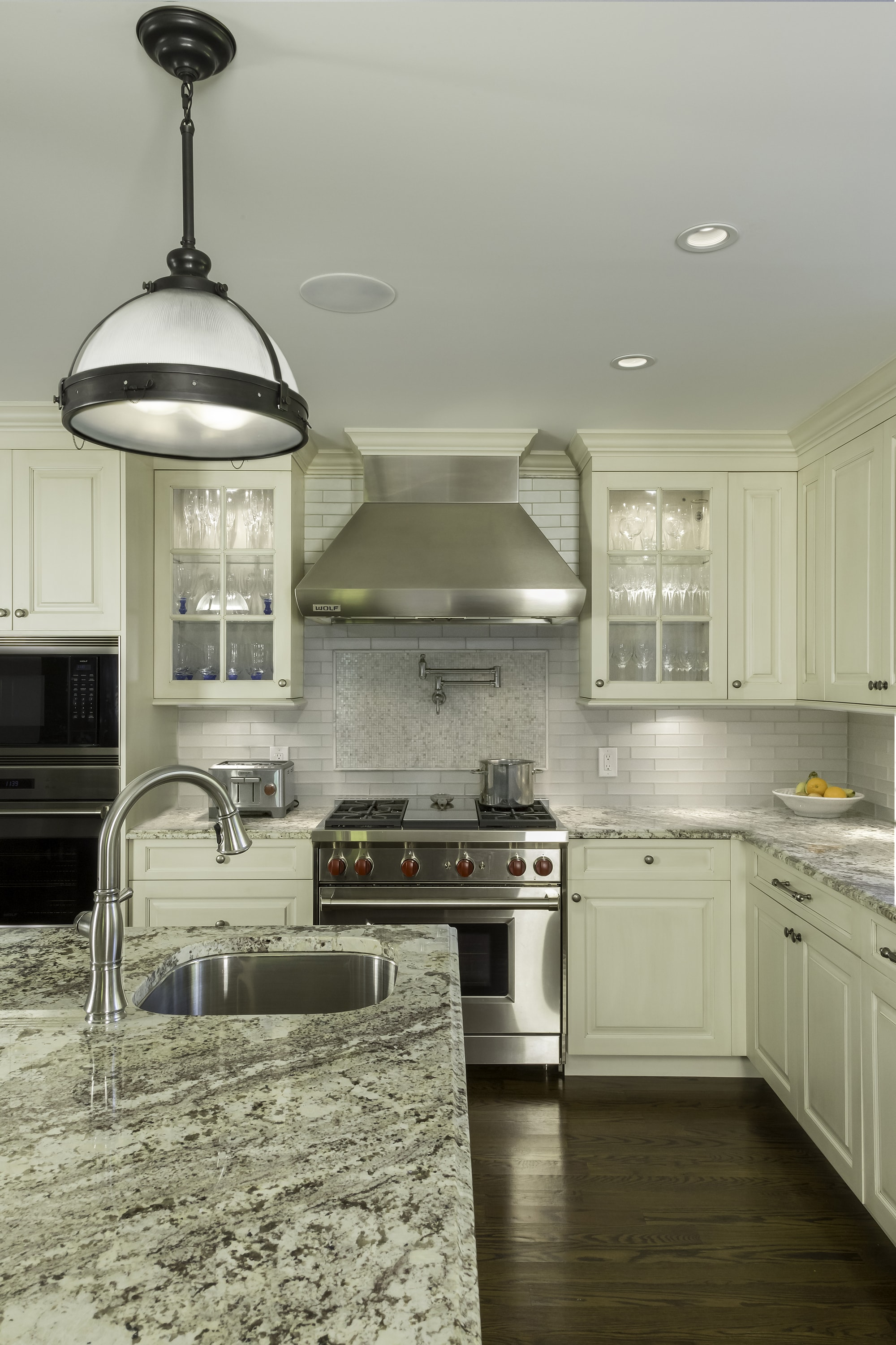 Traditional style kitchen with stainless range hood