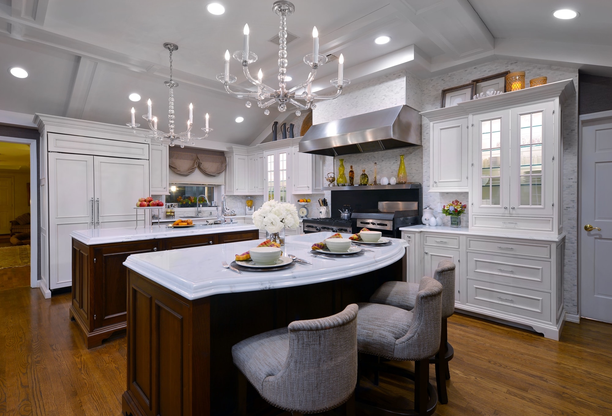 Traditional style kitchen with crystal chandeliers