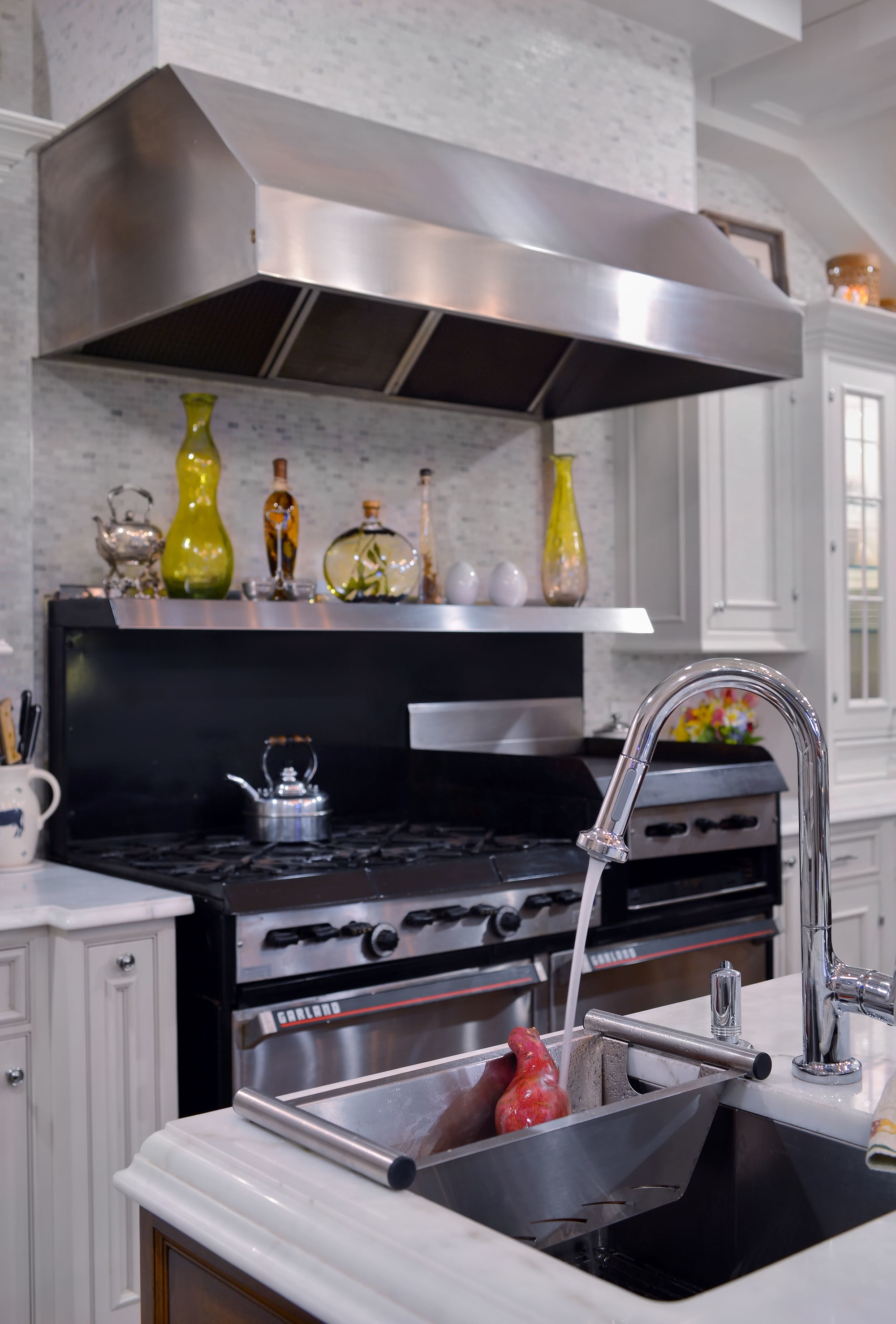 Traditional style kitchen with steel faucet