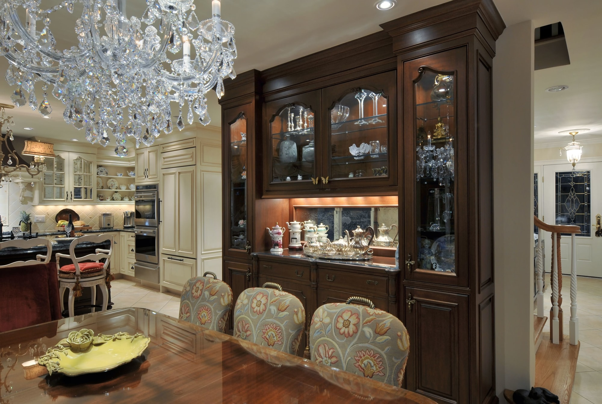 Traditional style kitchen with bright light setting and crystal chandelier