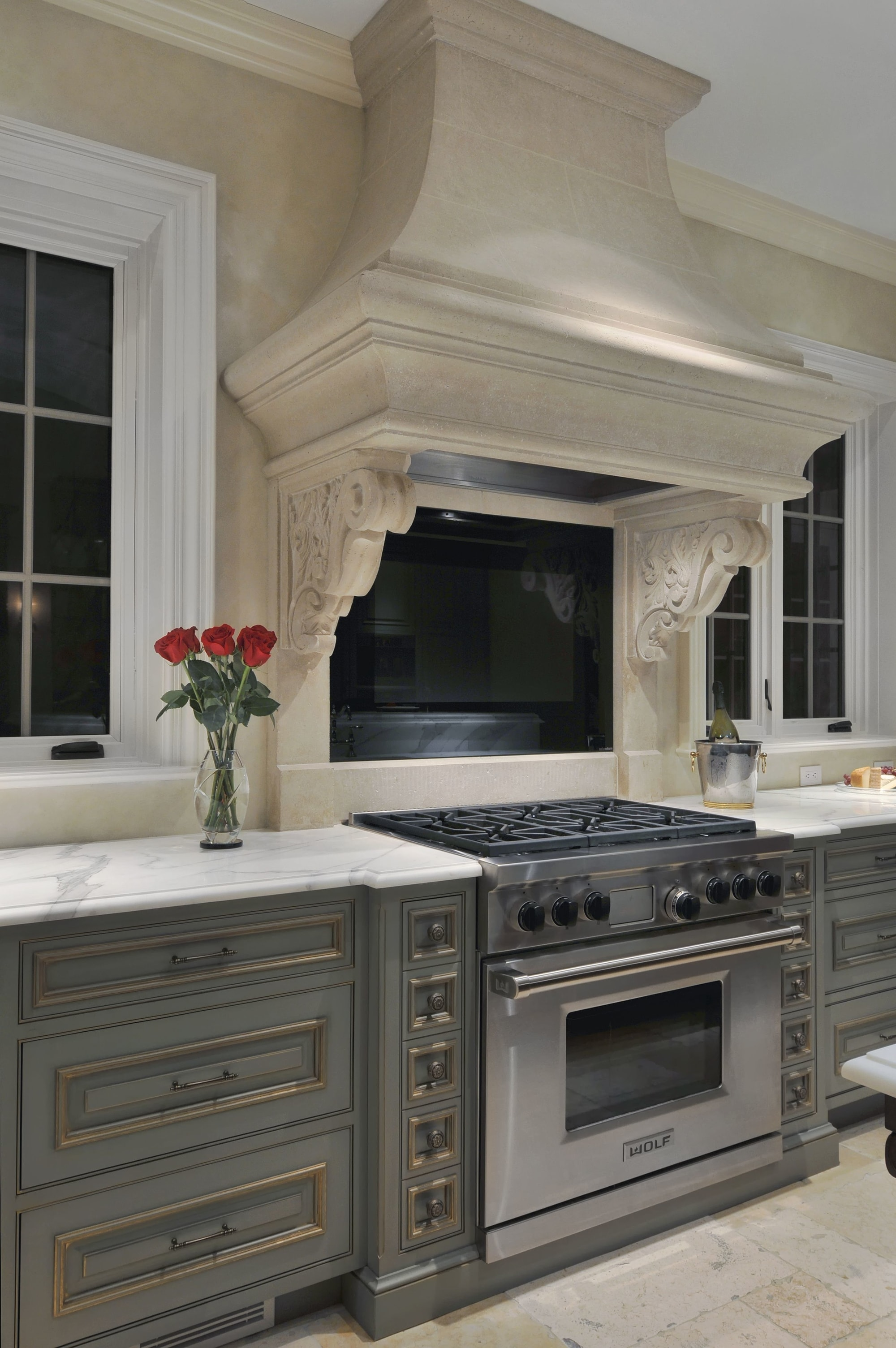 Traditional style kitchen with range oven and hood range