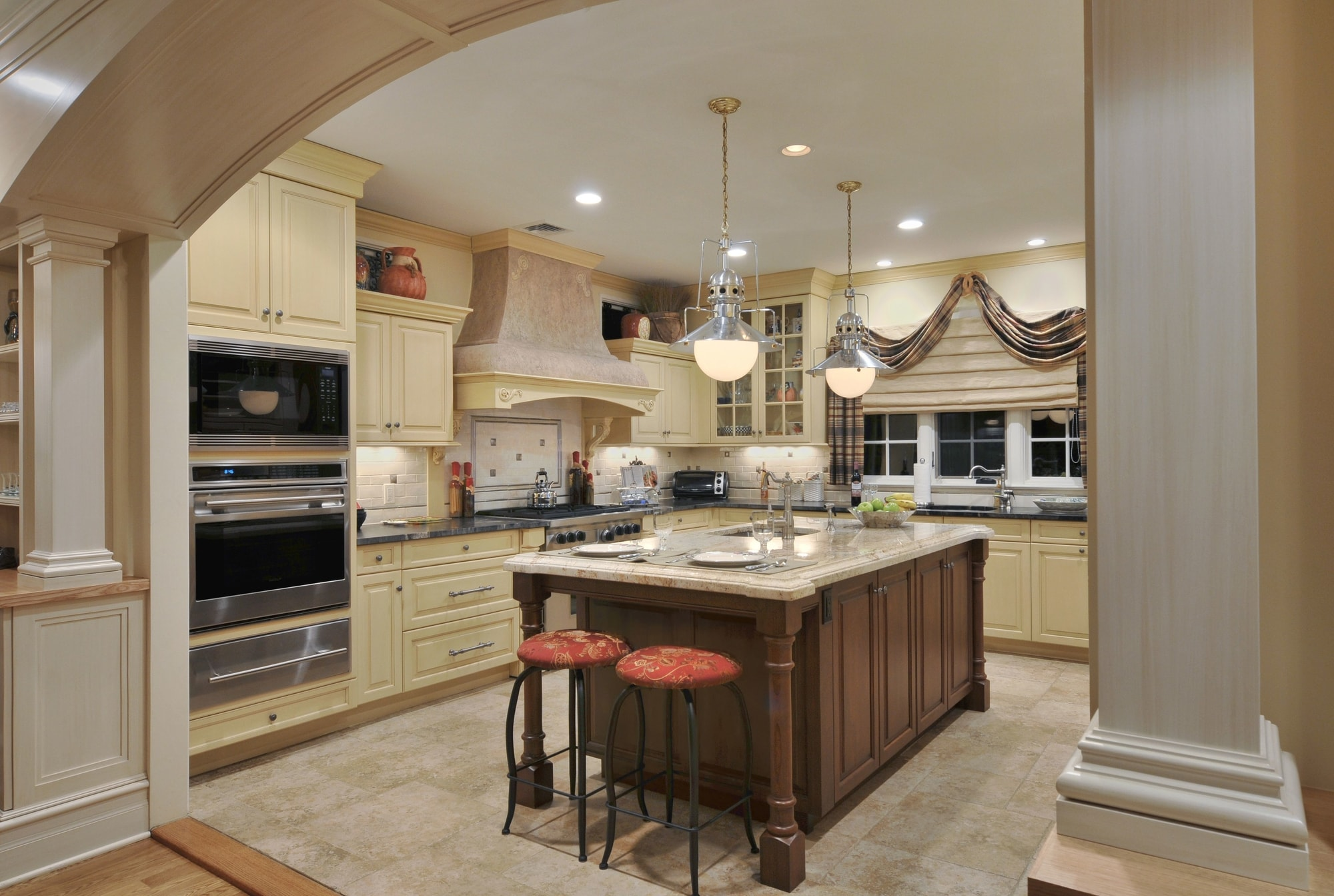 Traditional style kitchen with tiled floor and center island