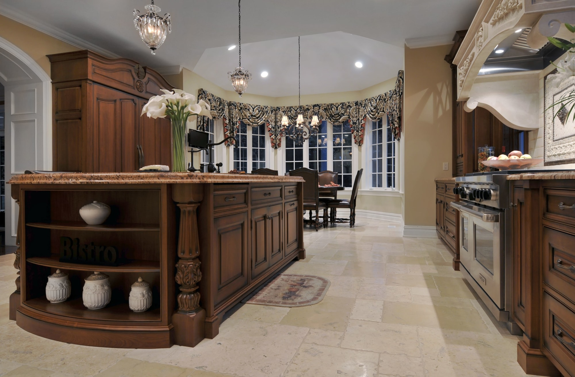 Traditional style kitchen with pendant lighting and chandelier
