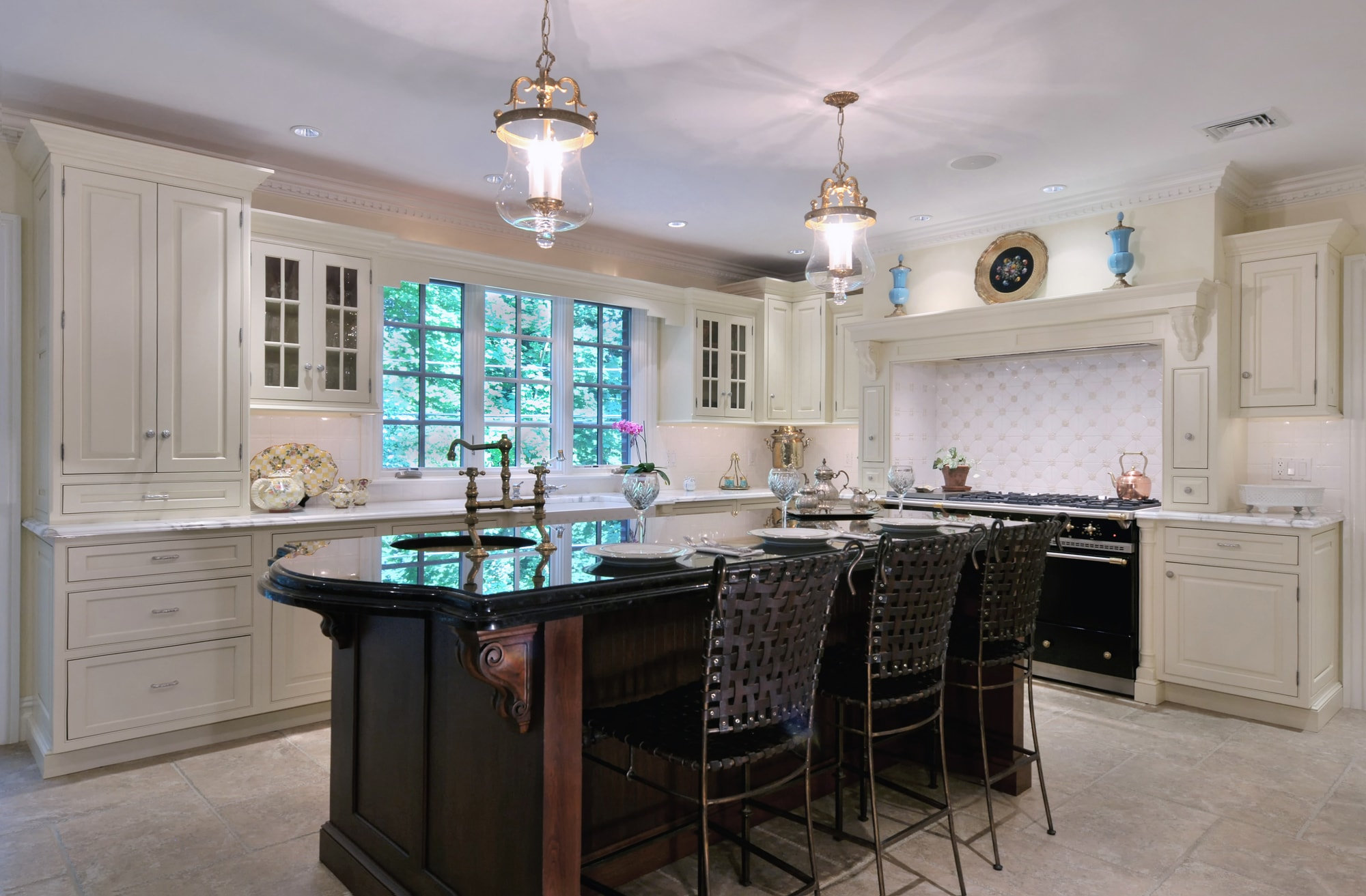 Traditional style kitchen with white cabinets and white tiled floors