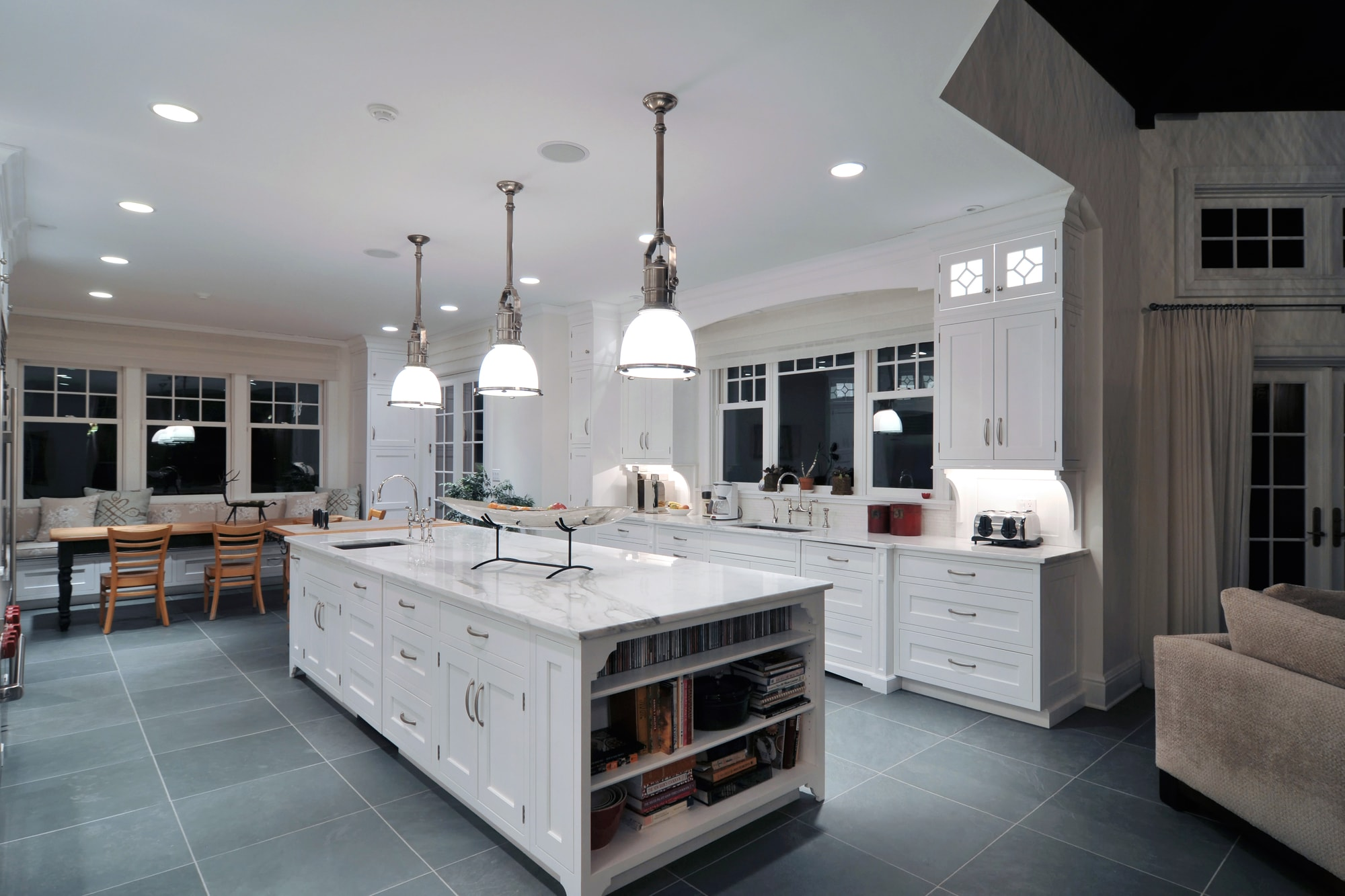 Traditional style kitchen with custom built shelf on kitchen island