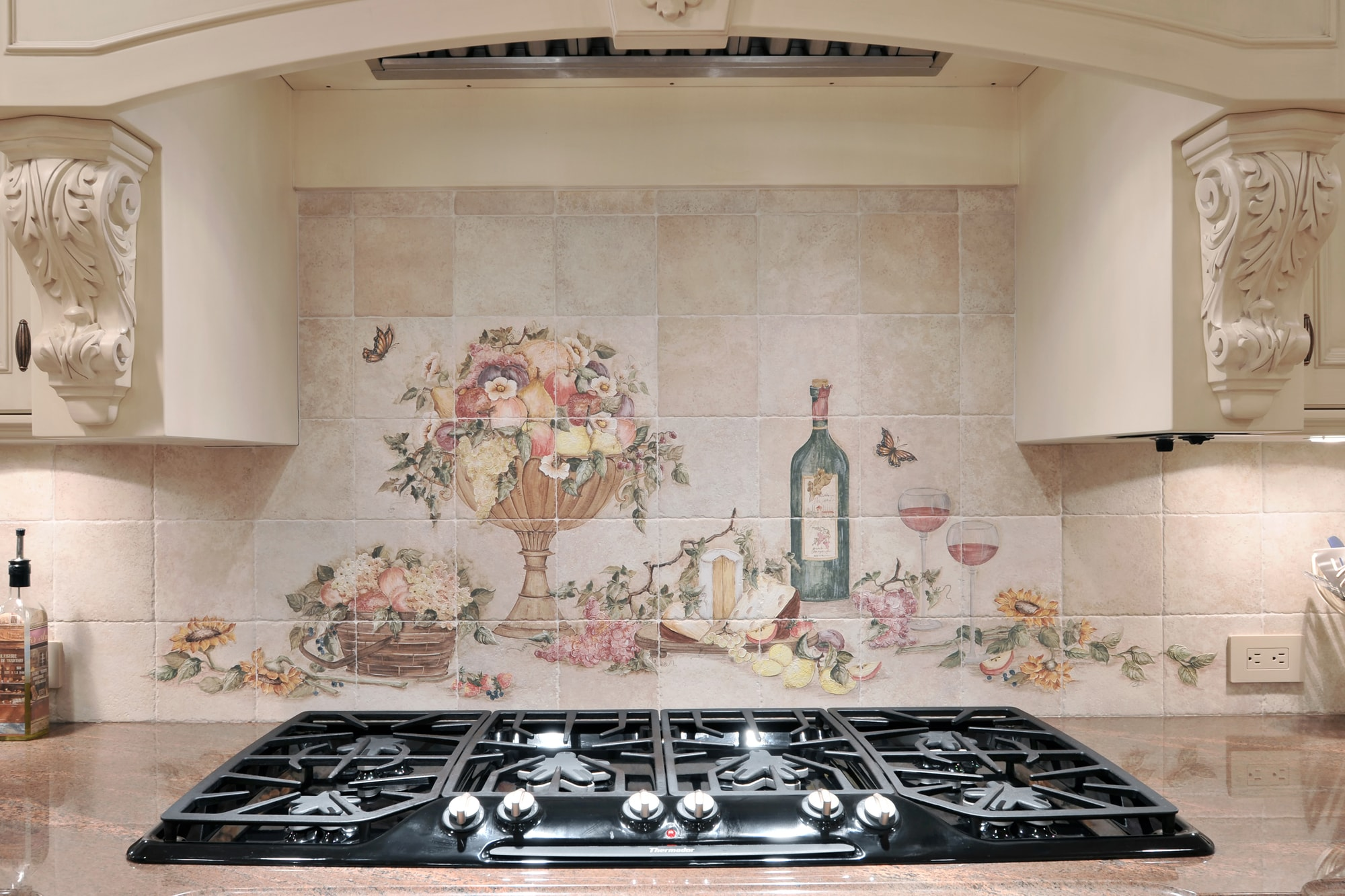 Traditional style kitchen with range and range hood