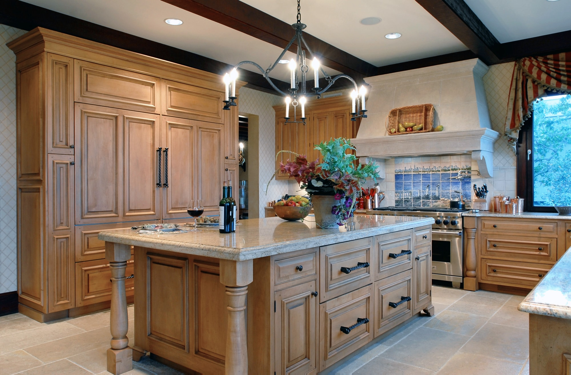 Traditional style kitchen with granite counter and classic chandelier